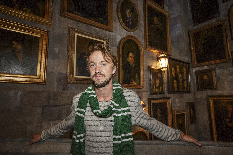 Tom Felton, who played Draco Malfoy, inside the Portrait Gallery in Hogwarts Castle.