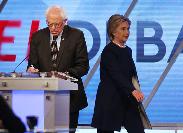 Democratic presidential candidate Senator Bernie Sanders (D-VT) and Democratic presidential candidate Hillary Clinton are seen on stage during a break in the broadcast of the Univision News and Washington Post Democratic Presidential Primary Debate at the Miami Dade College's Kendall Campus on March 9, 2016 in Miami, Florida.