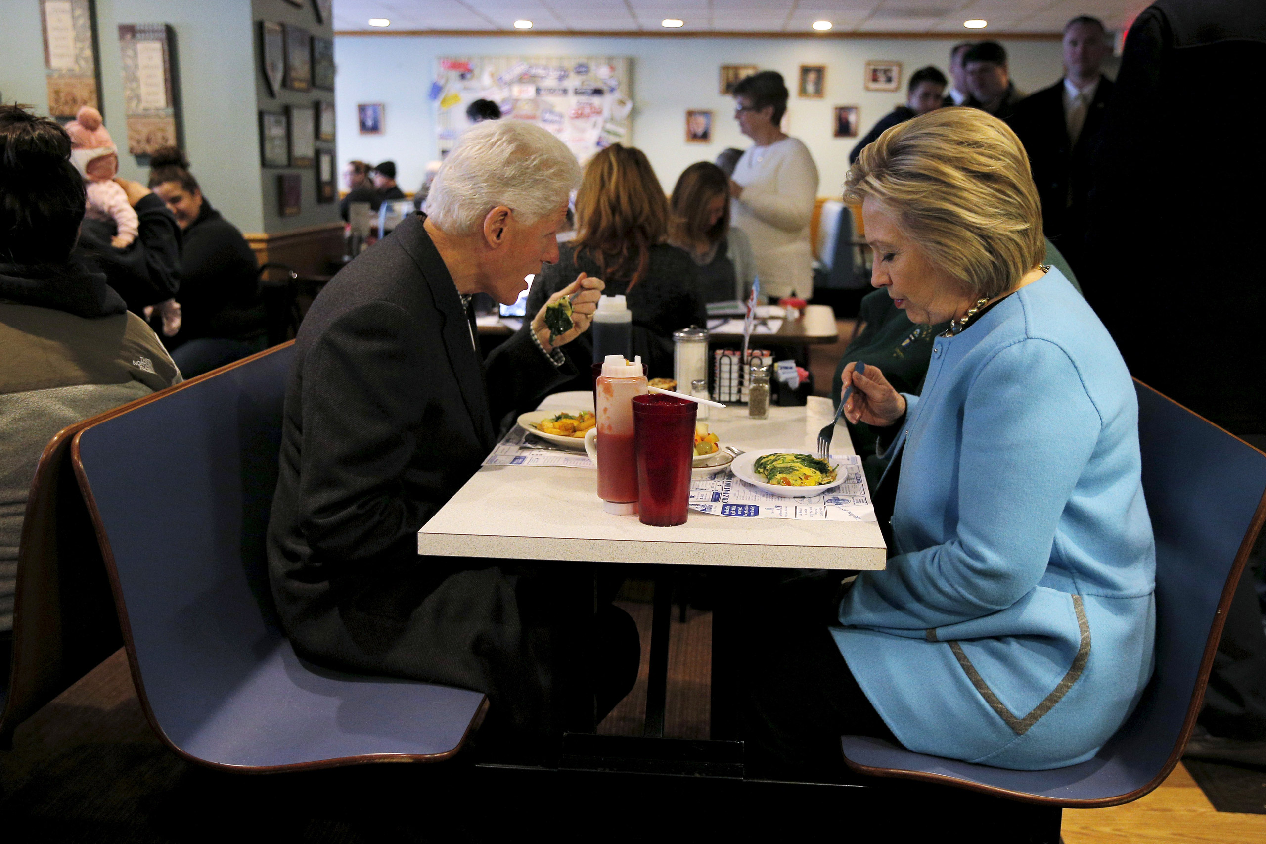 Democratic presidential candidate Hillary Clinton and her husband, former President Bill Clinton eat breakfast at the Chez Vachon restaurant in Manchester, N.H., on Febr. 8, 2016.