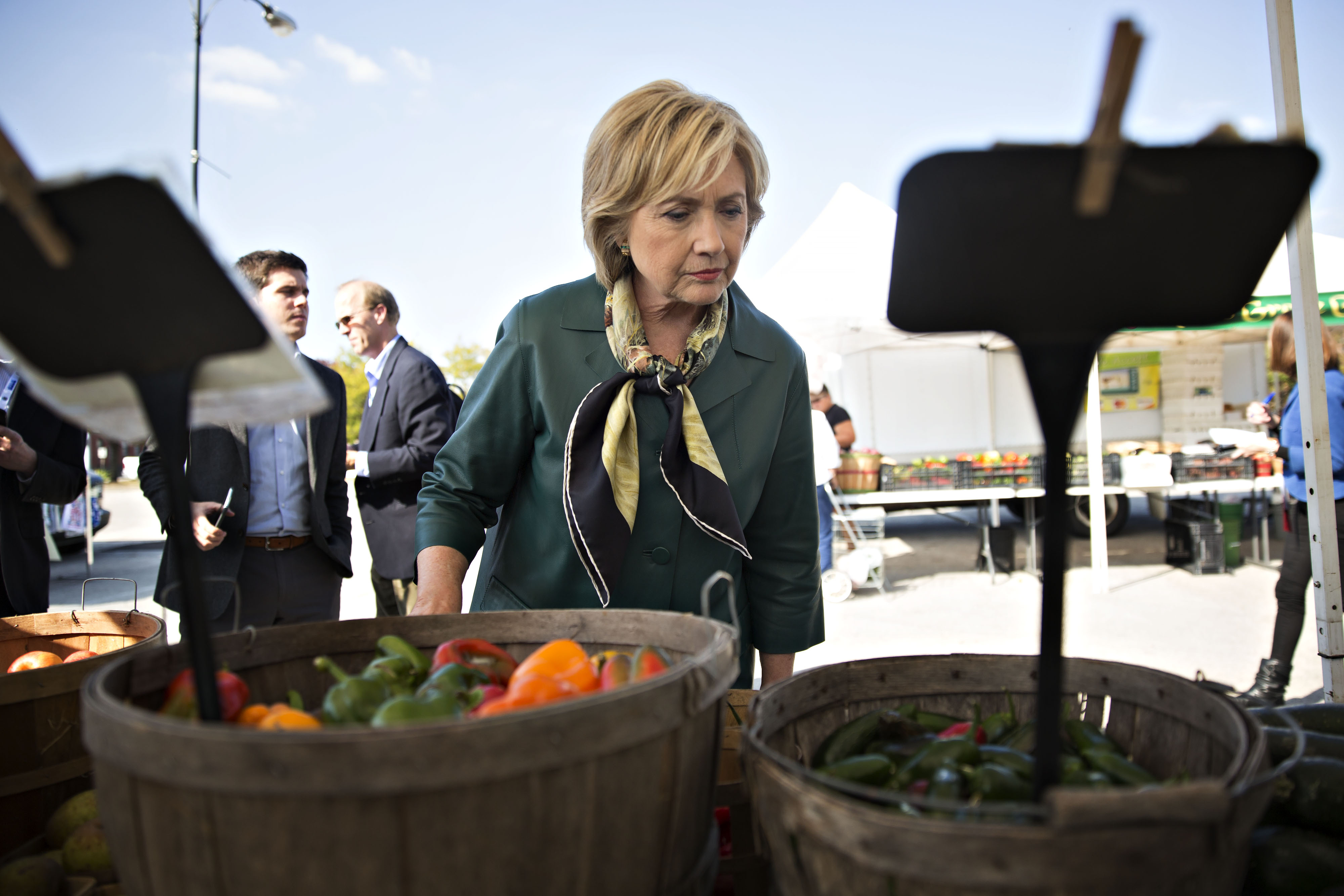 Hillary Clinton, former Secretary of State and 2016 Democratic presidential candidate, views a selection of peppers at a farmers market in Davenport, Iowa on Oct. 6, 2015.