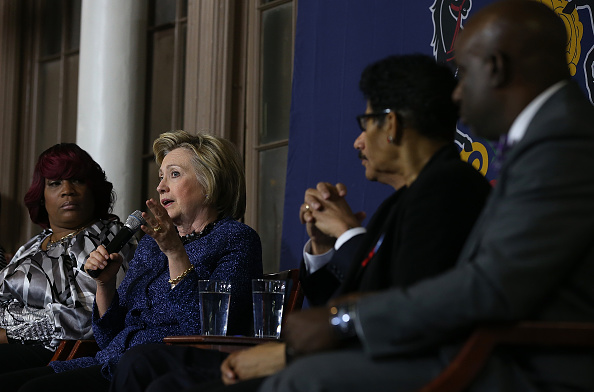 Democratic presidential candidate former Secretary of State Hillary Clinton (L) speaks during a panel discussion on gun violence at St. Paul's Baptist Church on April 20, 2016 in Philadelphia, Pennsylvania.