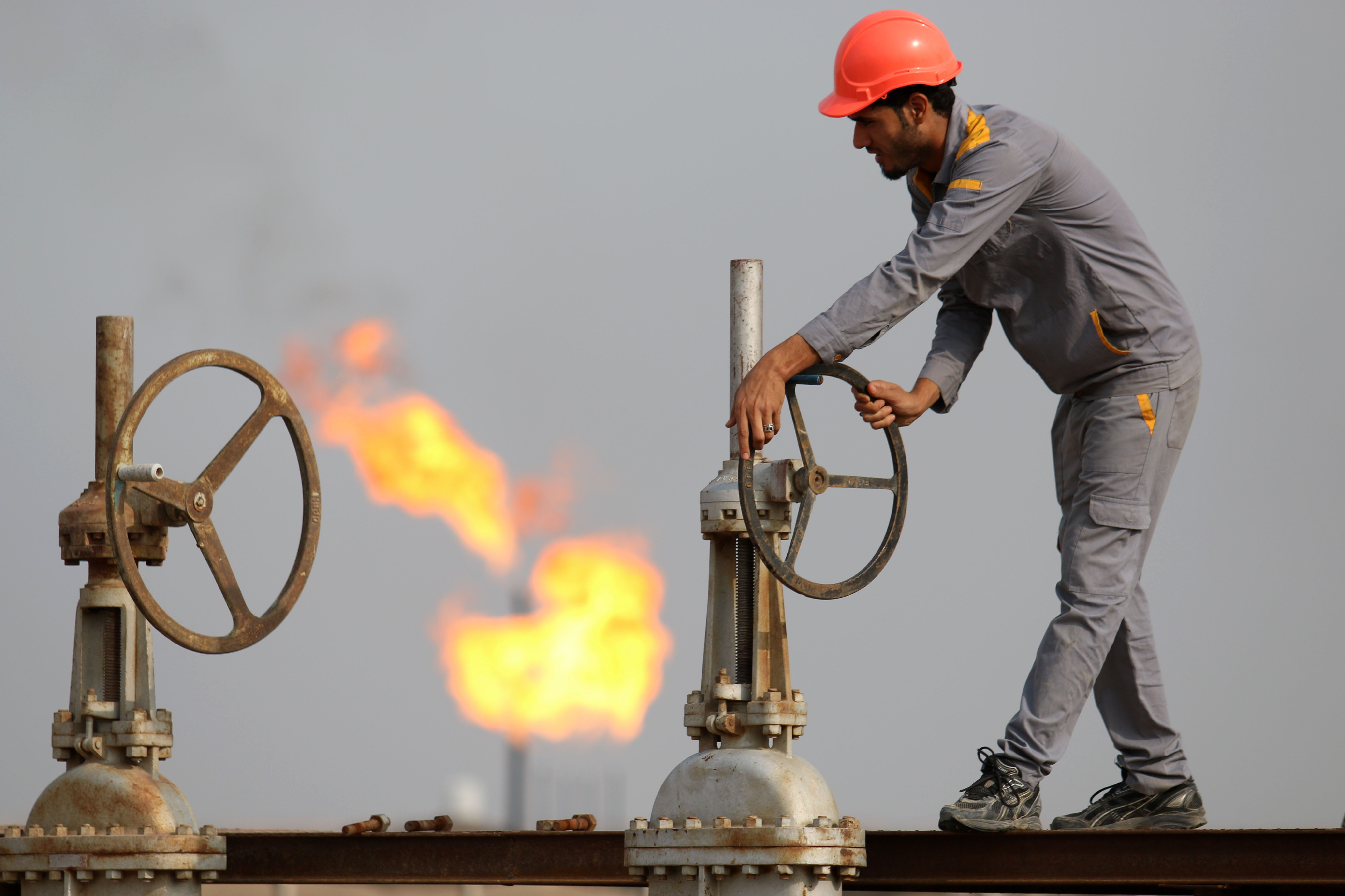 An Iraqi labourer works at an oil refinery in the southern town Nasiriyah on October 30, 2015.