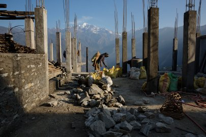 Villagers rebuild houses and pathways in the village of Barpak, in Gorkha district, Nepal, at the epicenter of the April and May 2015 earthquakes which killed 9000 people, April 6, 2016.