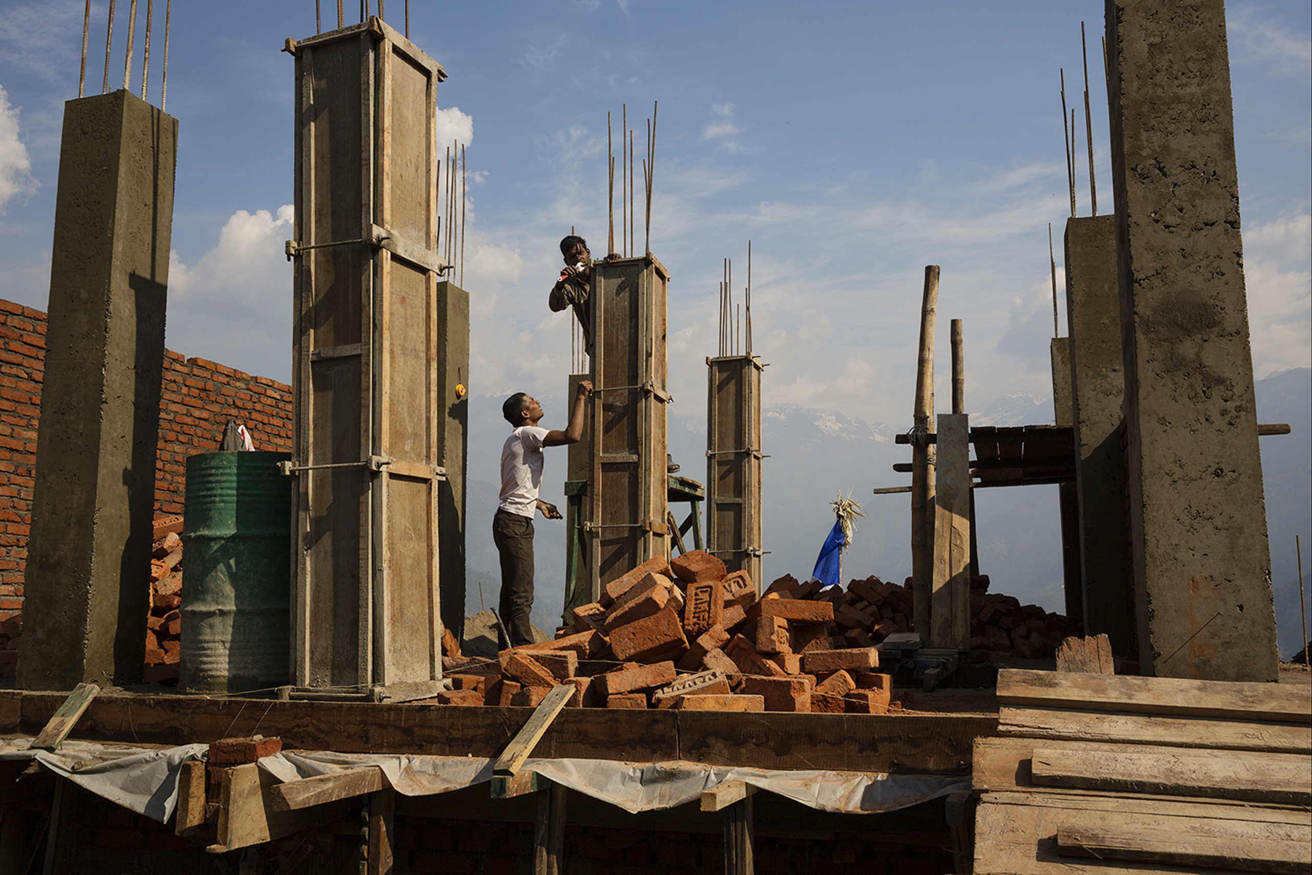 Villagers rebuilding houses on April 7, 2016, in Barpak, in Gorkha district, Nepal, at the epicenter of the 2015 earthquakes, which were the worst natural disaster to befall Nepal in more than eight decades