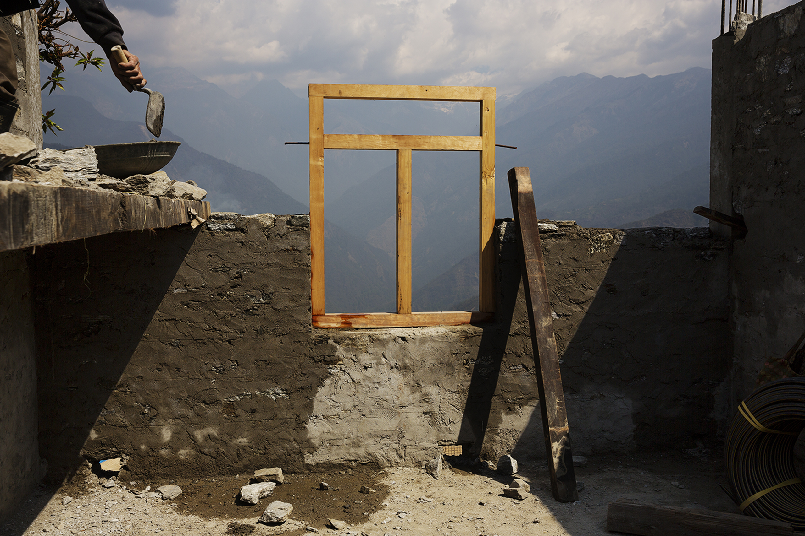 Approaching the first anniversary of Nepal's 2015 quakes, money from international donors has yet to reach victims. A  political fight overtook  reconstruction efforts, leaving villagers in communities like Barpak, needing to rebuild on their own, April 7, 2016.