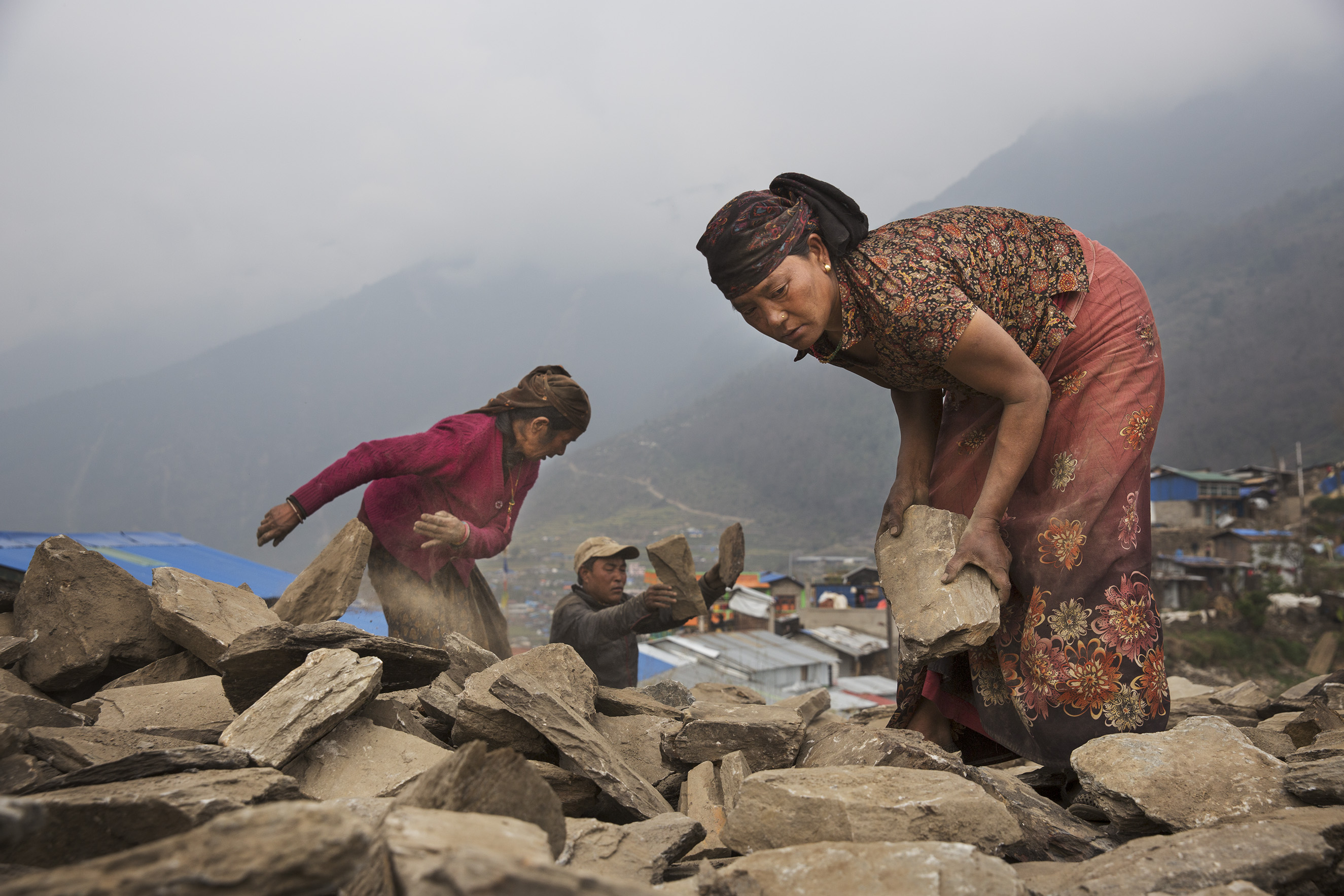 Nearly a year after Nepal's earthquakes of 2015, villagers work at rebuilding with little or no government support, Barpak, Nepal, April 3, 2016.From  James Nachtwey: A Year After the Devastating Earthquake
