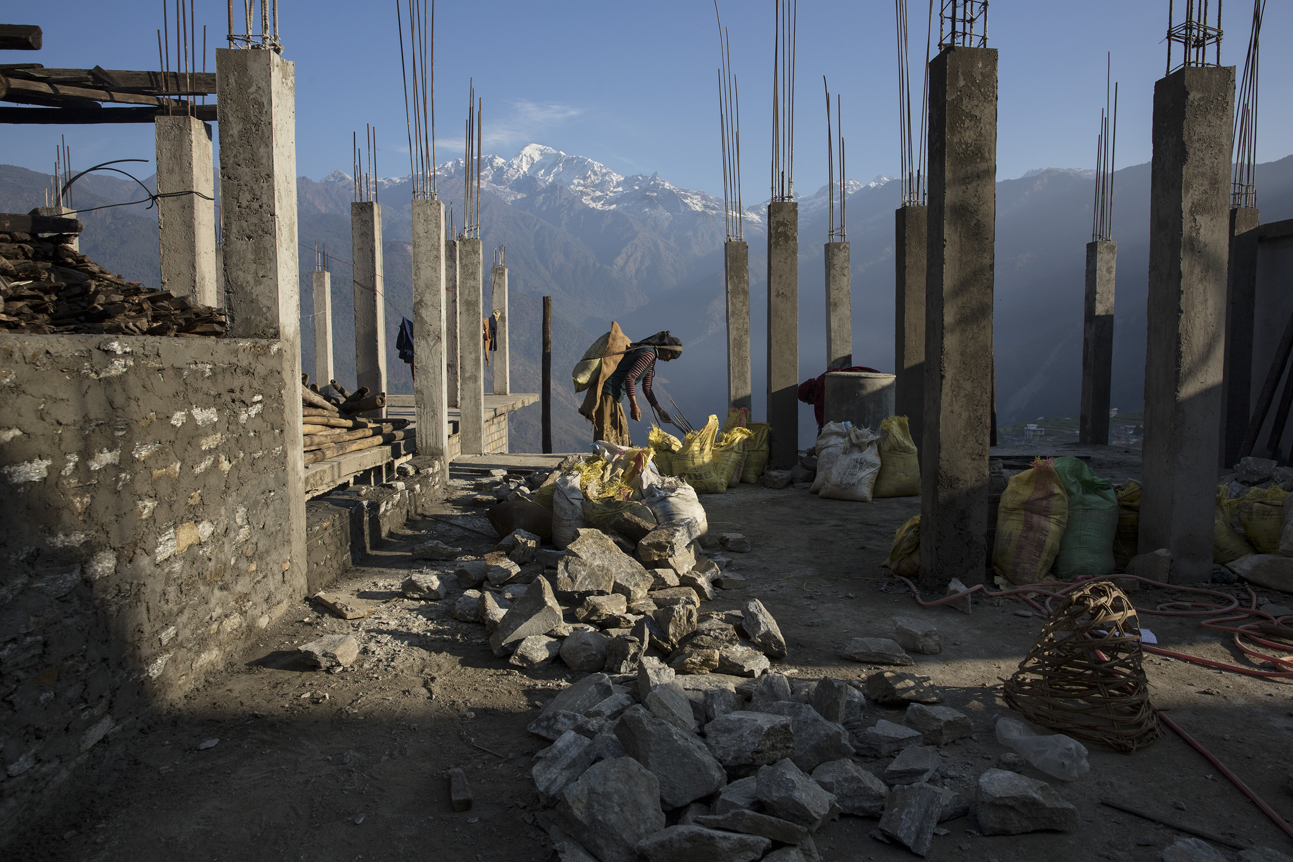 Villagers rebuild houses and pathways in the Himalayan village of Barpak, in Gorkha district, Nepal, at the epicenter of the April and May 2015 earthquakes which killed 9,000 people, April 6, 2016.From  James Nachtwey: A Year After the Devastating Earthquake