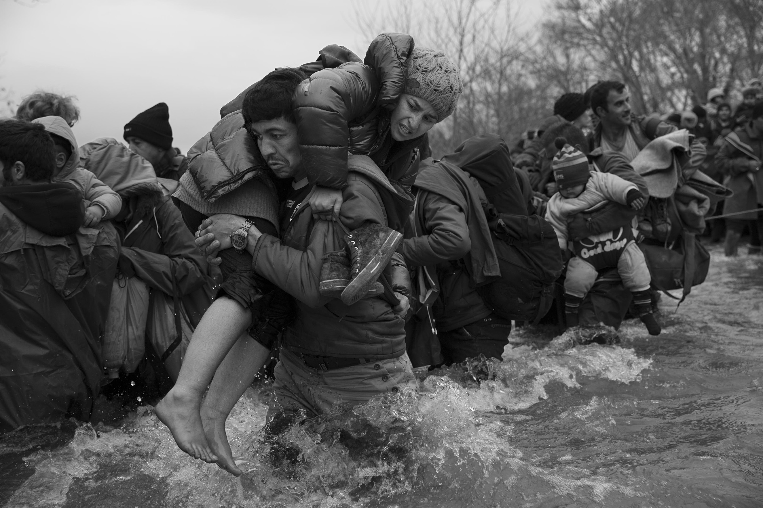 An estimated 1,000 migrants made their way from the sprawling camp in Idomeni, Greece and crossed a river near the border in the hopes of crossing into Macedonia, March 14, 2016.From  James Nachtwey: A New Purgatory for Thousands of Refugees