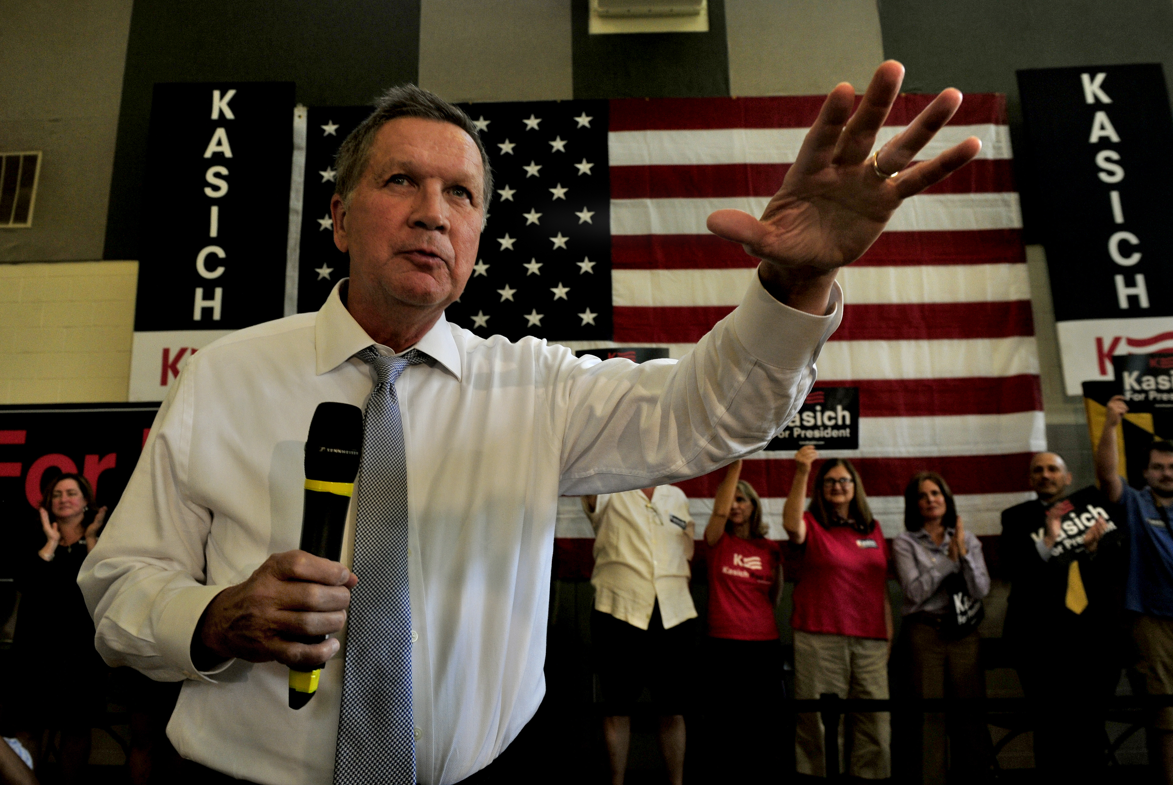 John Kasich waves to a cheering crowd at the start of his town hall rally in Rockville, Maryland on April 25.
