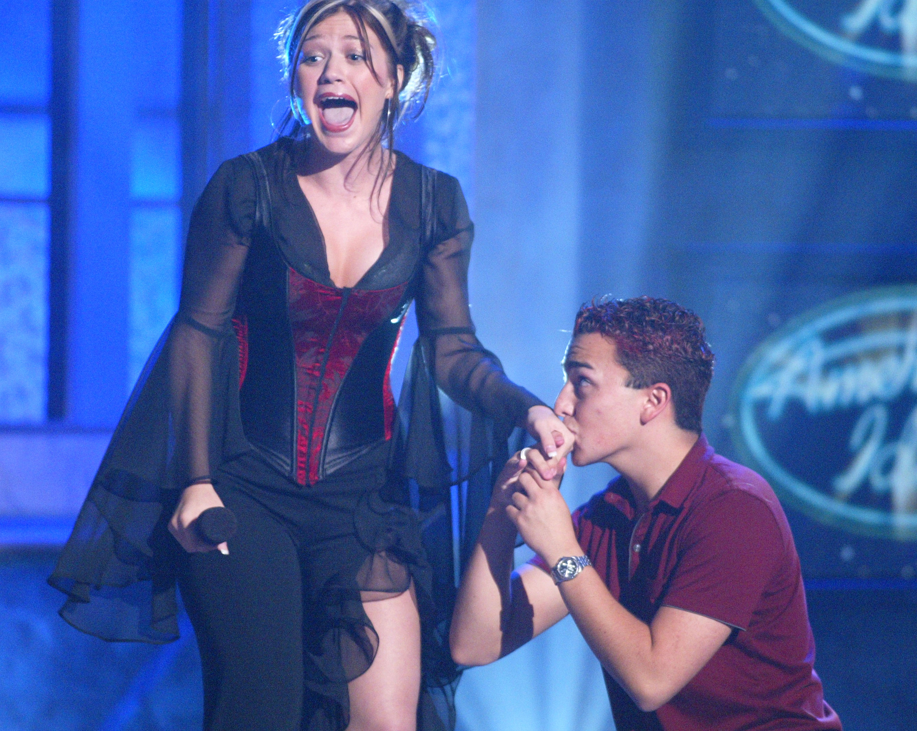 Kelly Clarkson is kissed by an audience member at FOX TV's  American Idol , in Los Angeles, on July 16, 2002.