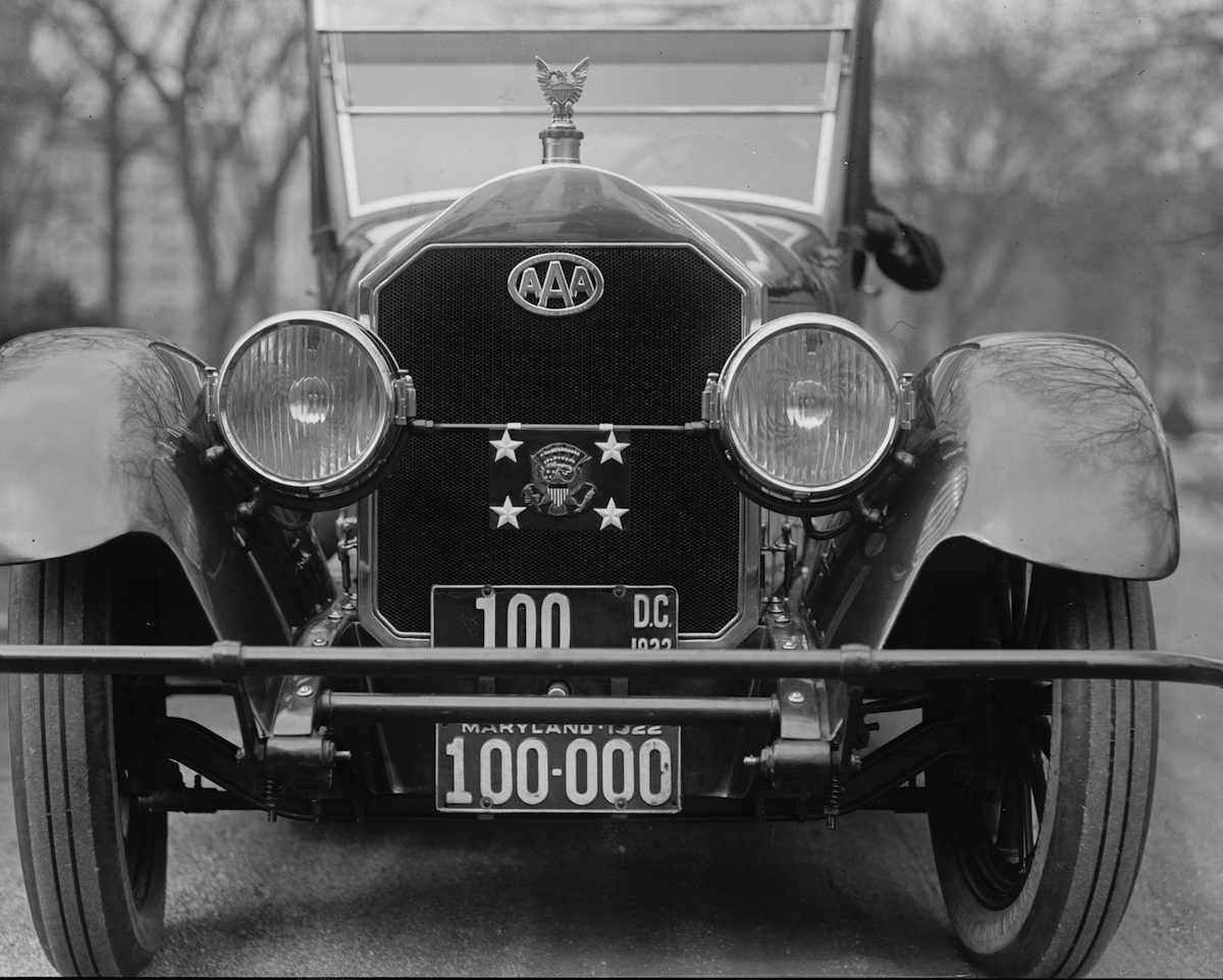 The Presidential Shield on the front of the President's car in 1922, above his license plate.