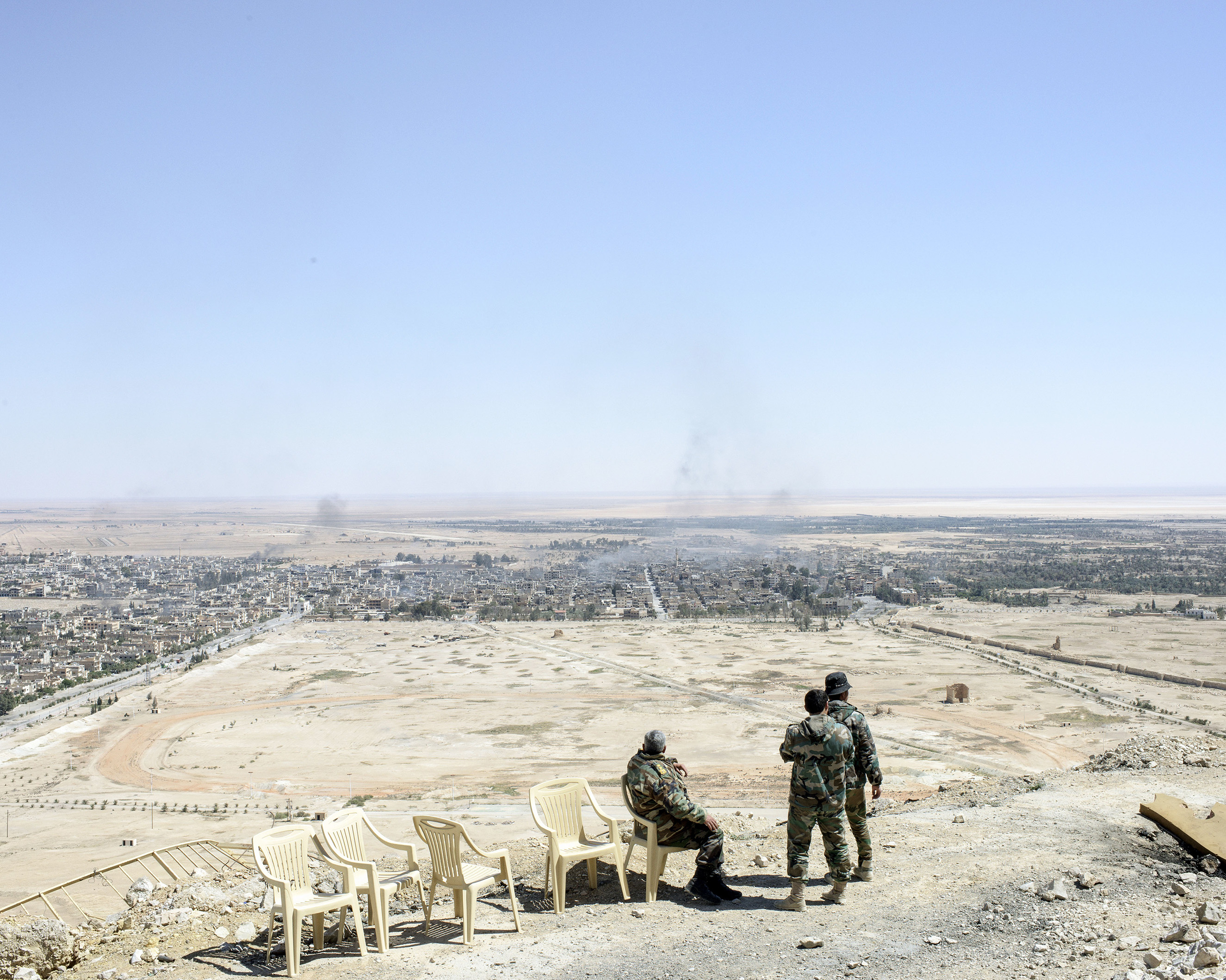 Syrian army generals and soldiers gaze over modern Palmyra from the medieval hilltop citadel, April 1, 2016.From  Inside War Ravaged Syria