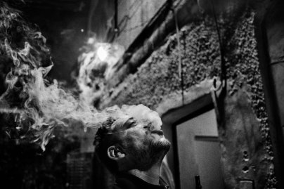 Muhannad Qafesha smokes shisha outside the headquarters of Youth Against Settlements, a Palestinian activist organization located in the Tel Rumeida neighborhood of Hebron, November 2015.