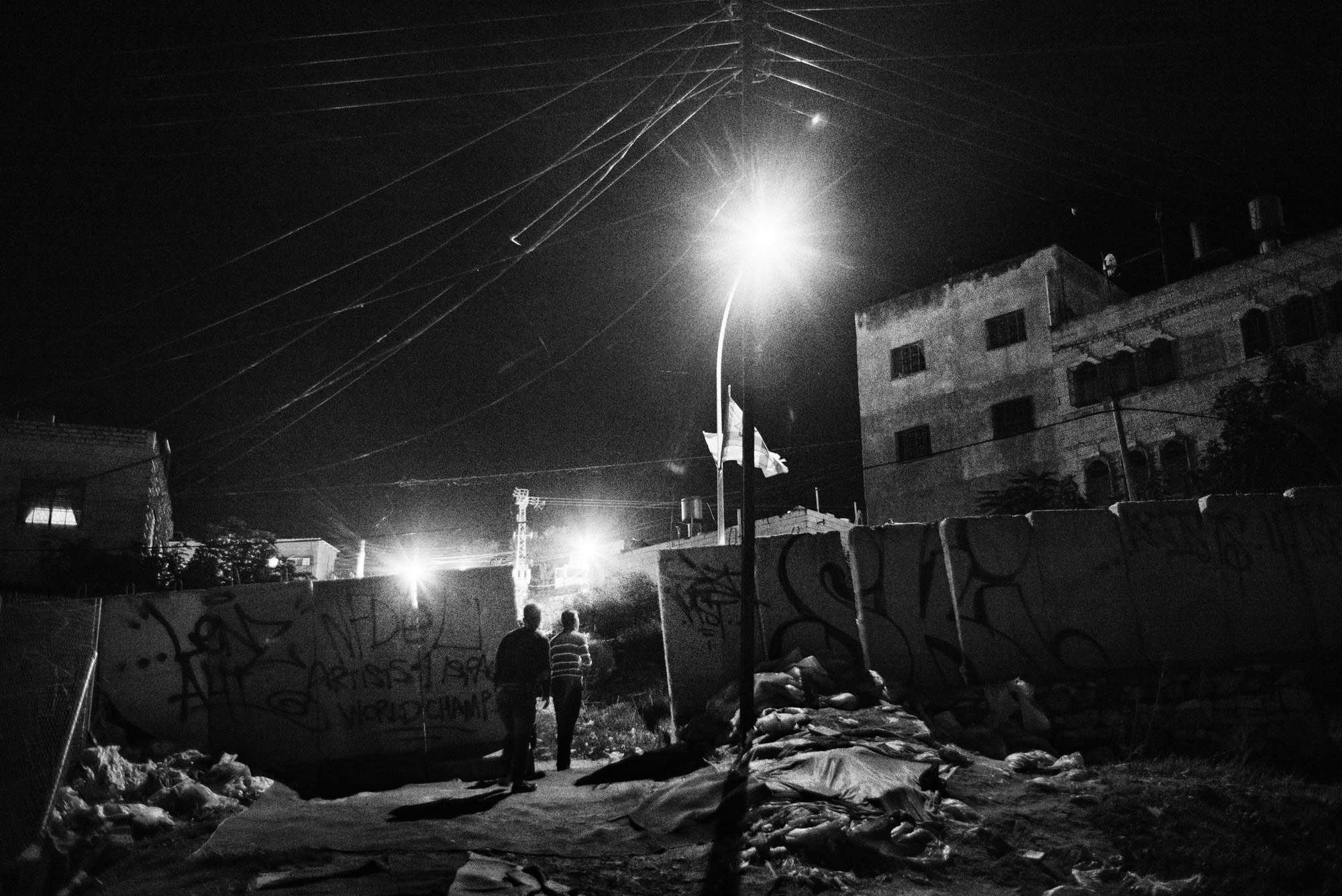 Residents of Tel Rumeida walk home at night, Hebron, November 2015.