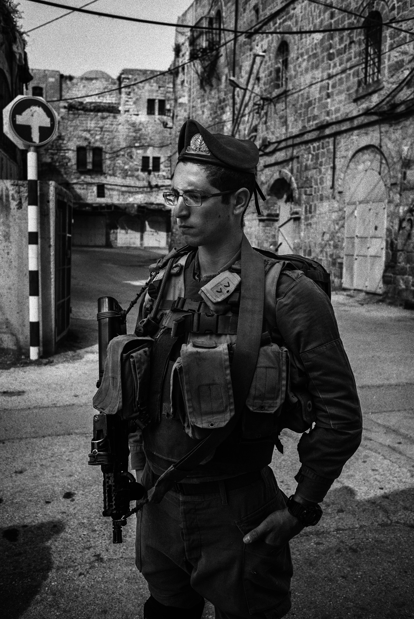 An Israeli soldier stands at a checkpoint in the H2 area of Hebron, November 2015. In late October a Palestinian man was fatally shot here while. Amnesty International said he was retrieving an ID card at the request of a soldier. The rights organization said Israeli authorities labeled the incident an  attempted stabbing.