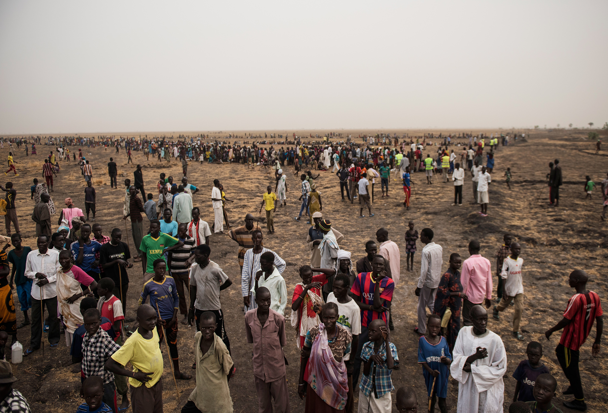 Tens of thousands of South Sudanese line up for food handouts on March 17, 2016. The fighting has left many in the country starving.From  The Only One God Left Alive