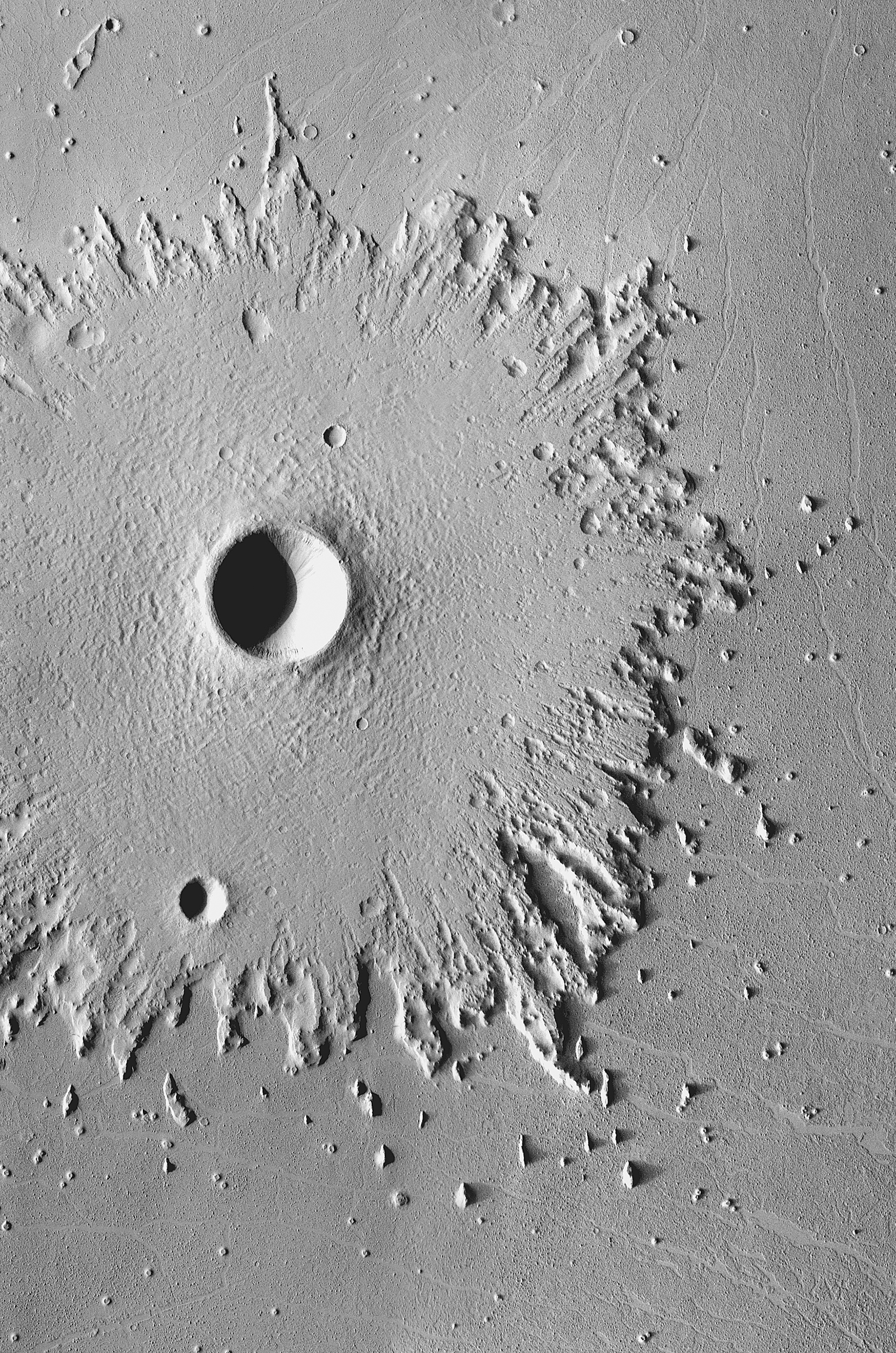 Radical Erosion:  The wide, circular blanket of ejected debris surrounding this crater has become greatly eroded by the wind, which has stripped its surface features.  This images was acquired between May 2003 and April 2006 by the Thermal Emission Imaging System instrument on NASA's Mars Odyssey orbiter.