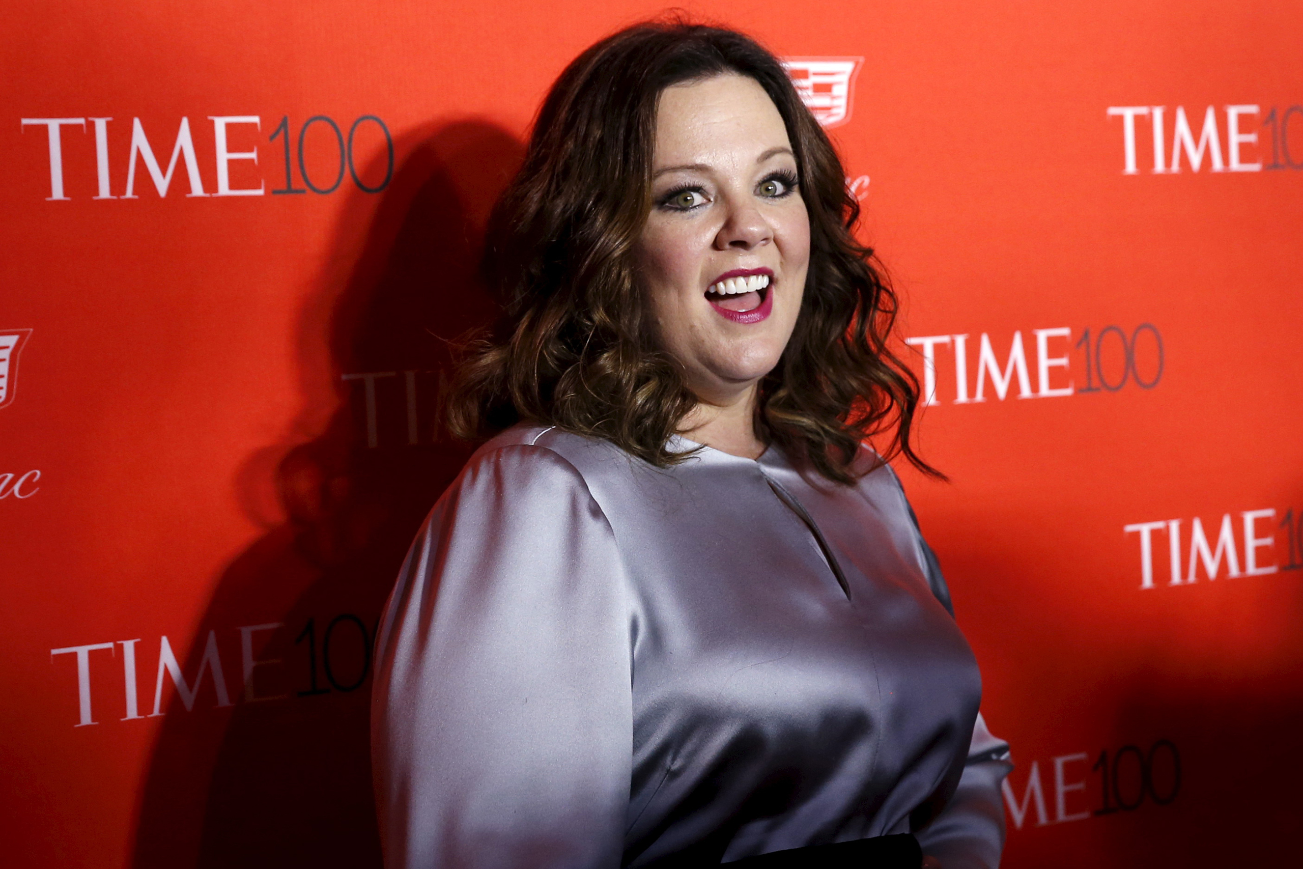 Actress Melissa McCarthy poses for photographers on the red carpet as she arrives for the TIME 100 Gala in New York, April 26, 2016.