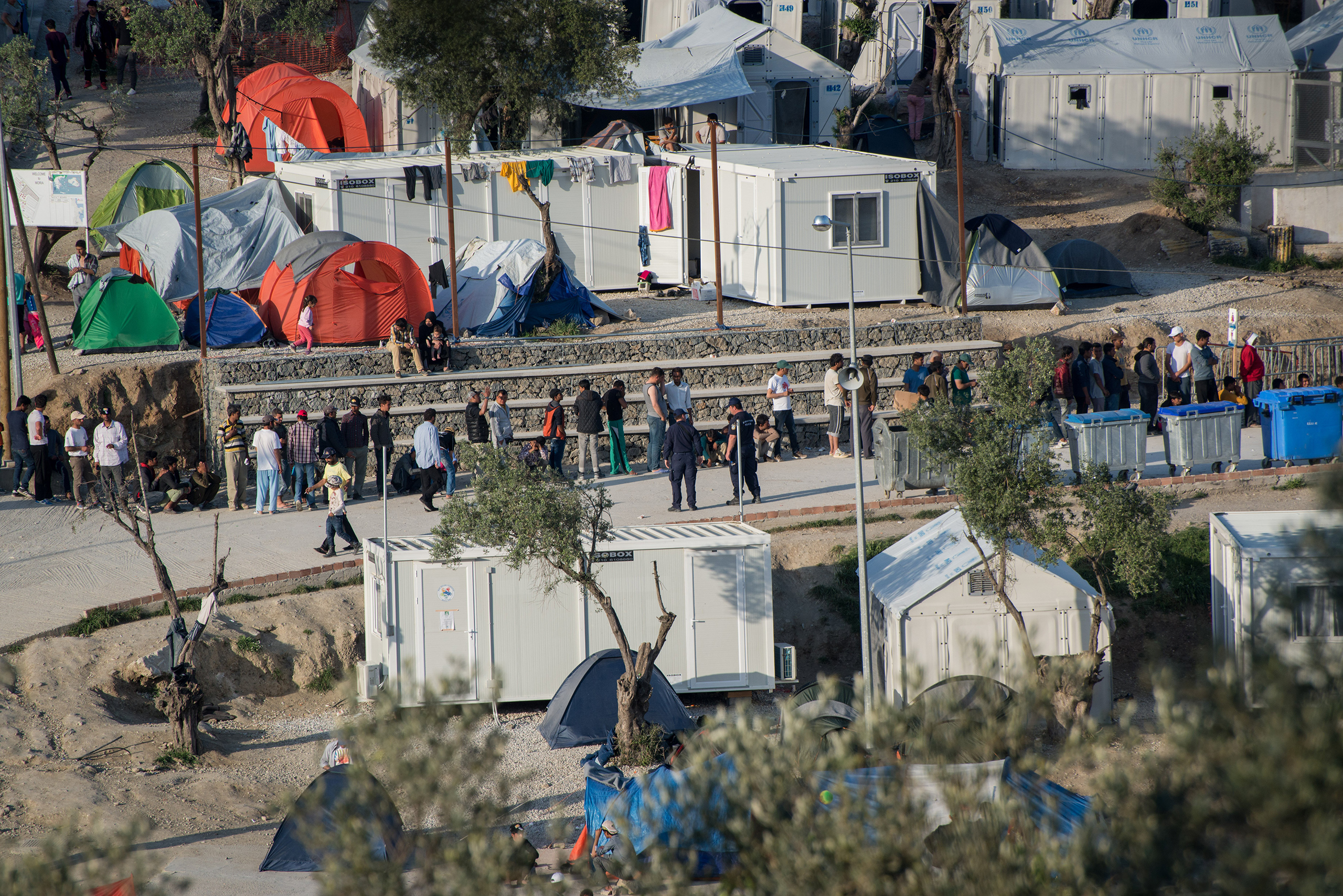 People wait in line at the Moria camp for migrants and refugees located in Mytilene, on the Greek island of Lesbos, April 13, 2016. Pope Francis will visit the island on April 15.
