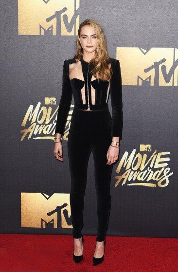 Cara Delevingne attends the 2016 MTV Movie Awards at Warner Bros. Studios on April 9, 2016 in Burbank, Calif.