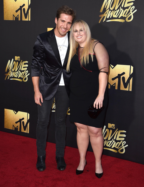 Hugh Sheridan and Rebel Wilson attend the 2016 MTV Movie Awards at Warner Bros. Studios on April 9, 2016 in Burbank, Calif.
