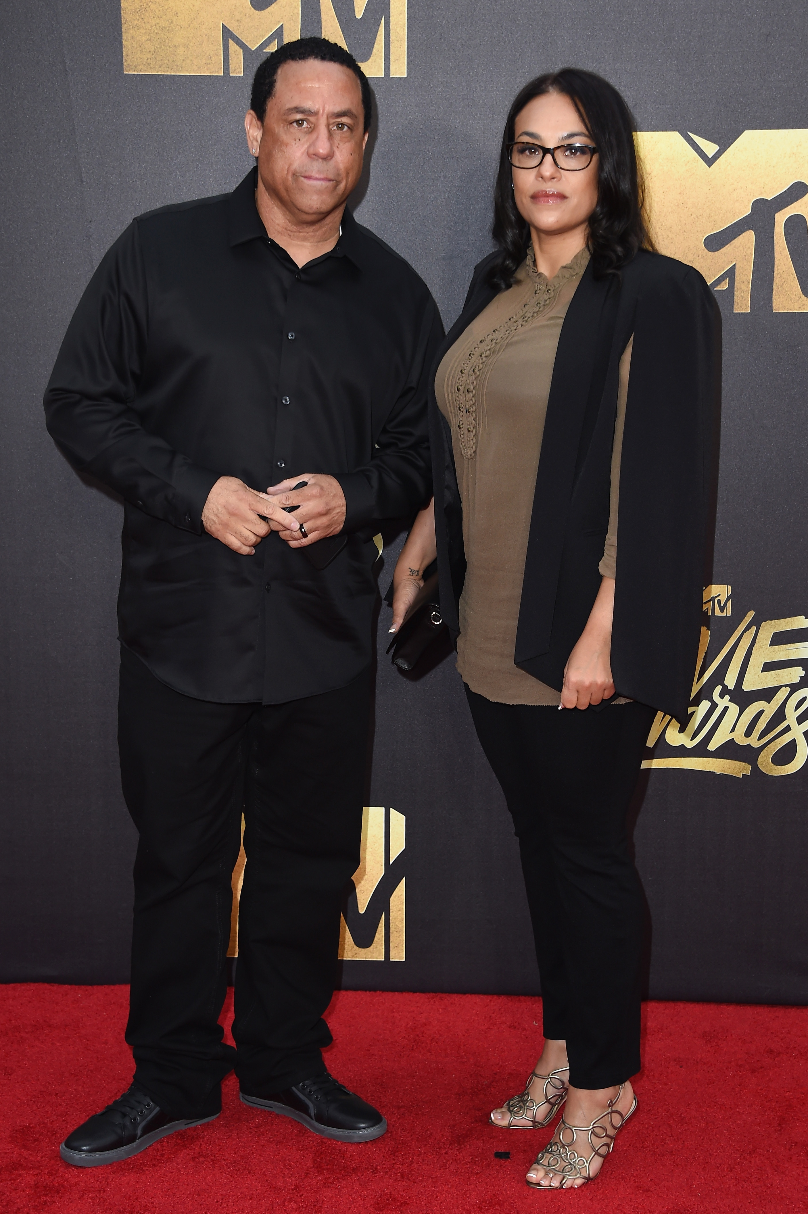 DJ Yella of N.W.A and producer Tomica Woods-Wright attend the 2016 MTV Movie Awards at Warner Bros. Studios on April 9, 2016 in Burbank, Calif.