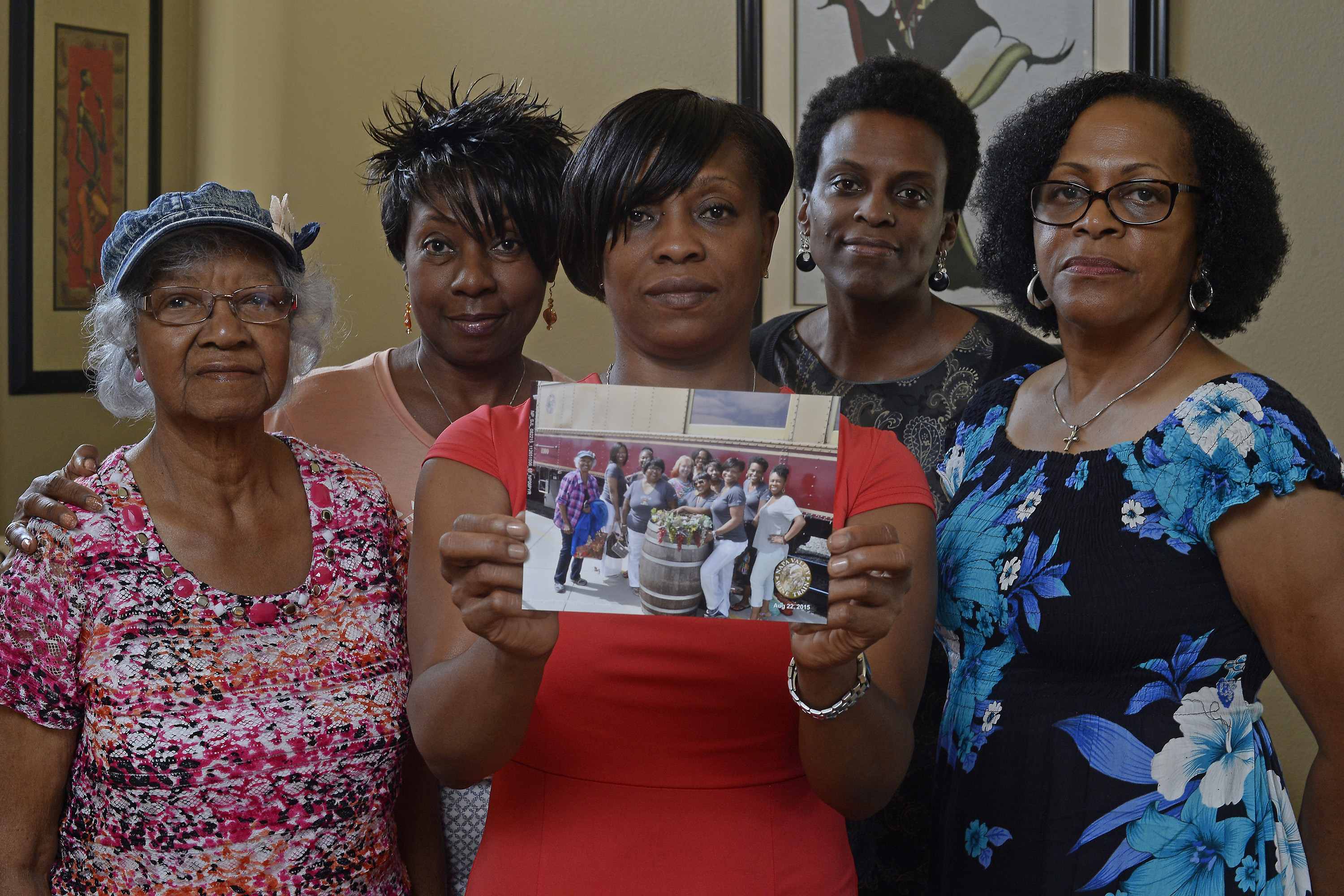 Five members of the Sistahs on the Reading Edge book club stand together in Antioch on Aug. 24, 2015.