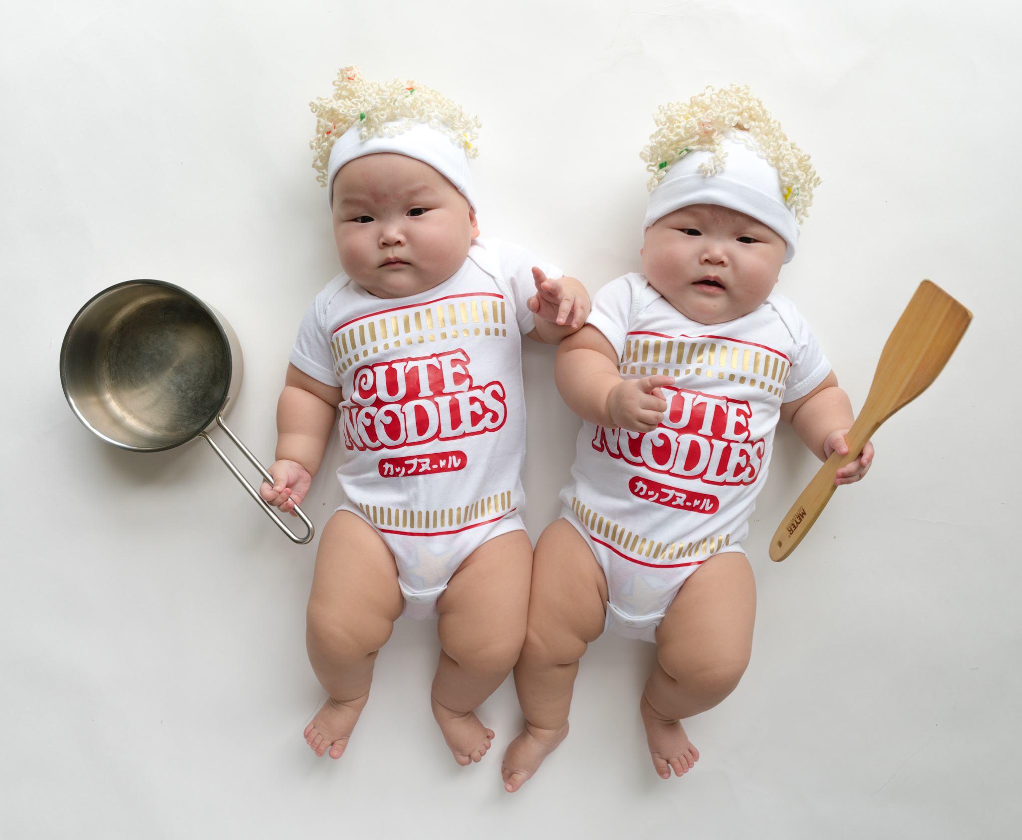 The adorable outfits include mermaid costumes, cup-of-noodles costumes and cute onesies with funny slogans.