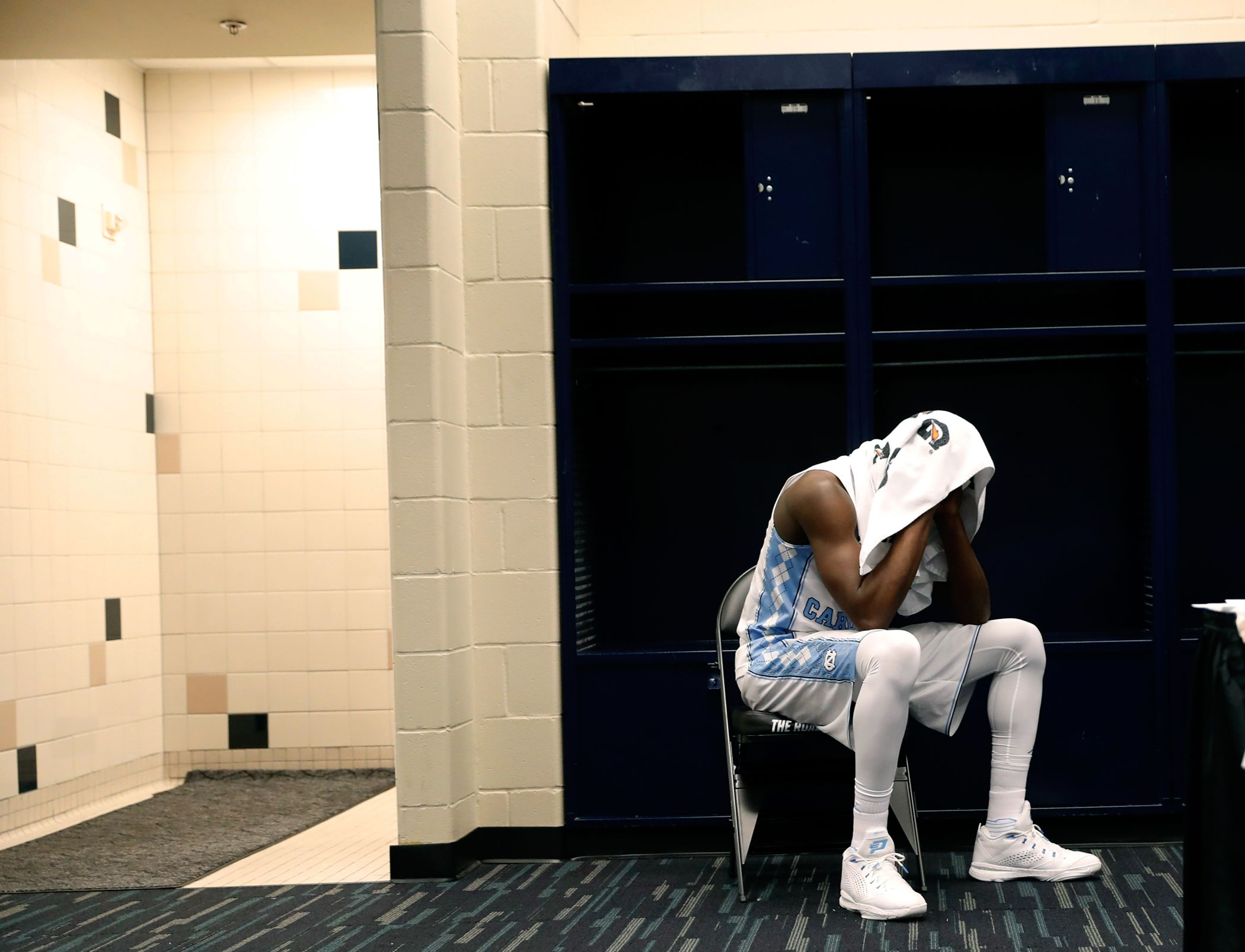North Carolina's Theo Pinson sits in the locker room after Villanova defeated North Caroline in the NCAA college basketball National Championship game on April 4, 2016 in Houston.