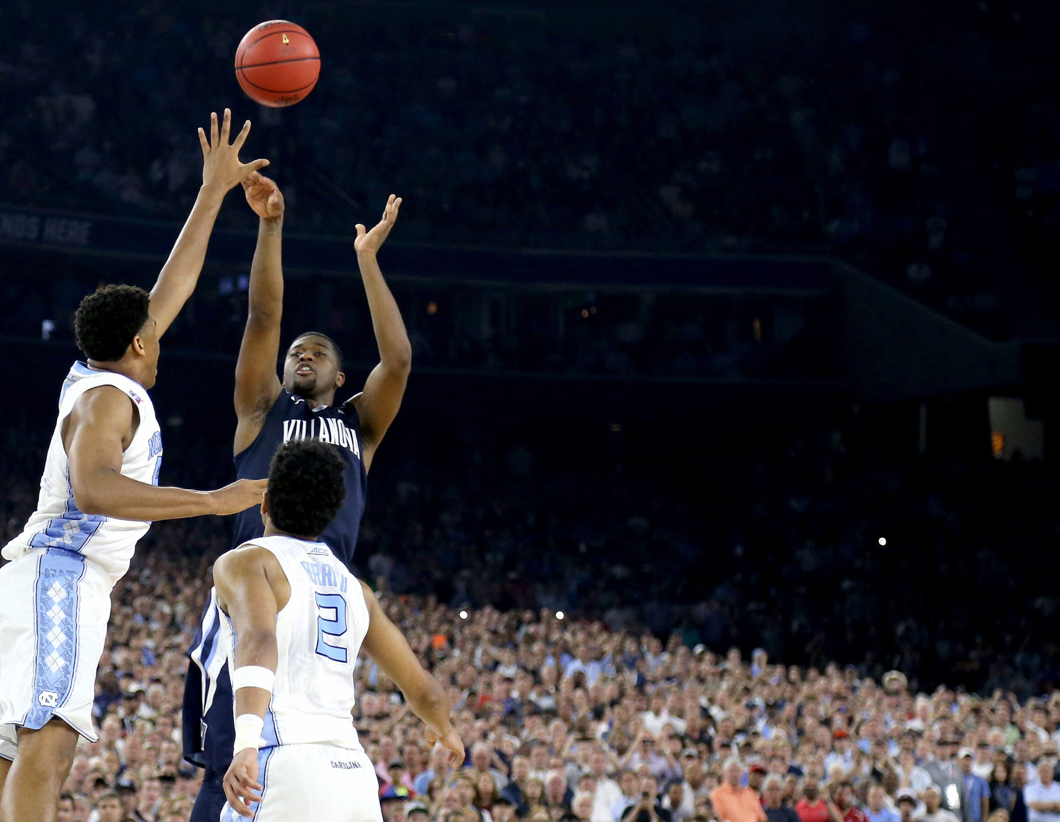Villanova Wildcats' Kris Jenkins (2) shoots the game-winning three pointer to defeat the North Carolina Tar Heels 77-74 in the NCAA college basketball National Championship  game on April 4, 2016 in Houston.