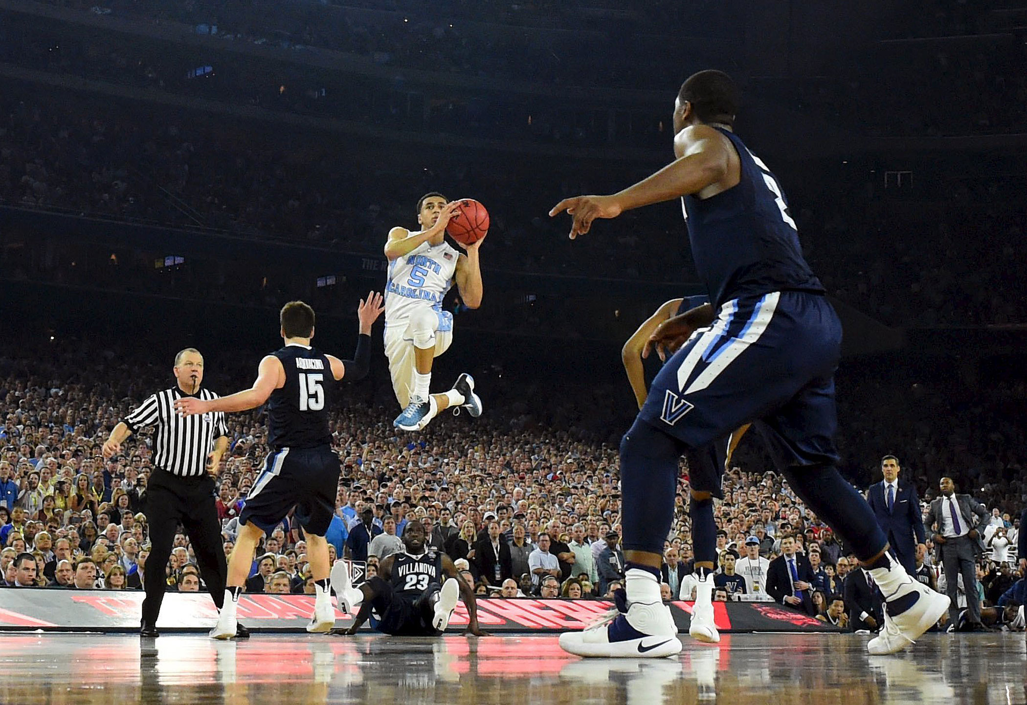 North Carolina Tar Heels guard Marcus Paige (5) shoots and scores a three-point basket against the Villanova Wildcats in the second half of the NCAA college basketball National Championship  game on April 4, 2016 in Houston.
