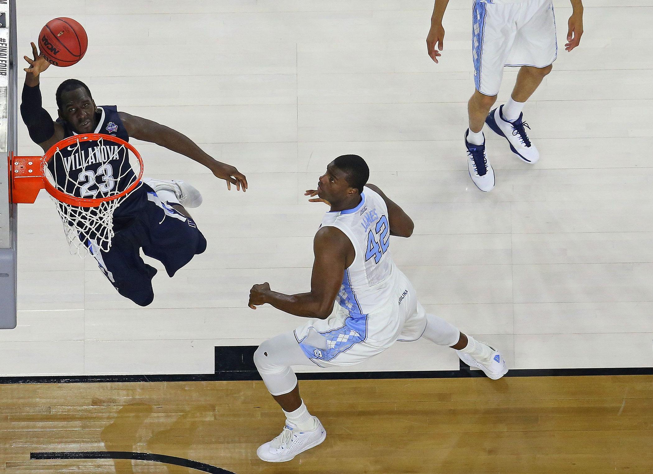 Villanova Wildcats Daniel Ochefu (23) lays up the ball up against North Carolina Tar Heels' Joel James (42) during the NCAA college basketball National Championship  game on April 4, 2016 in Houston.