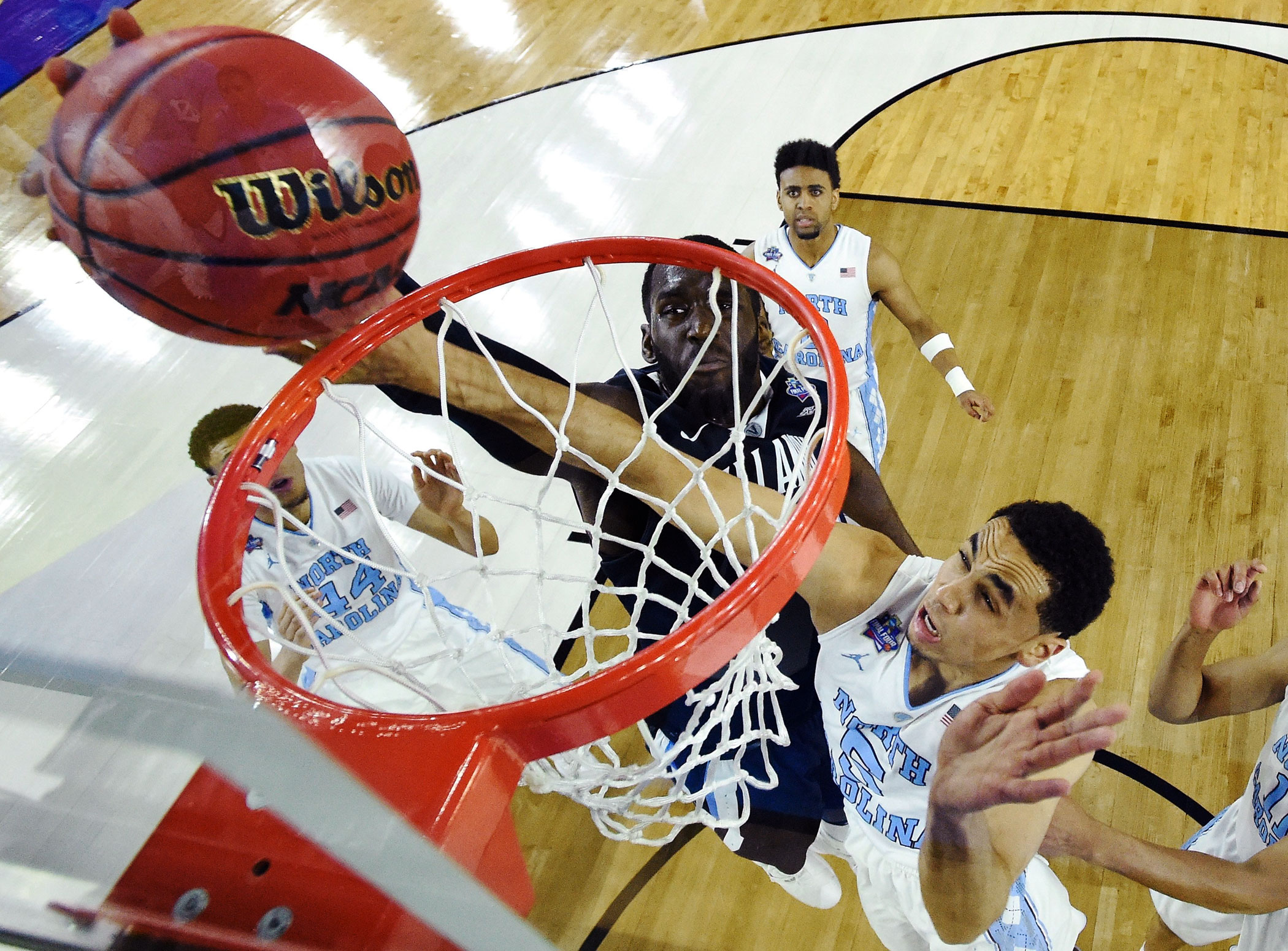 Villanova Wildcats' Daniel Ochefu (23) shoots against  North Carolina Tar Heels' Marcus Paige (5) in the first half of the NCAA college basketball National Championship  game on April 4, 2016 in Houston.
