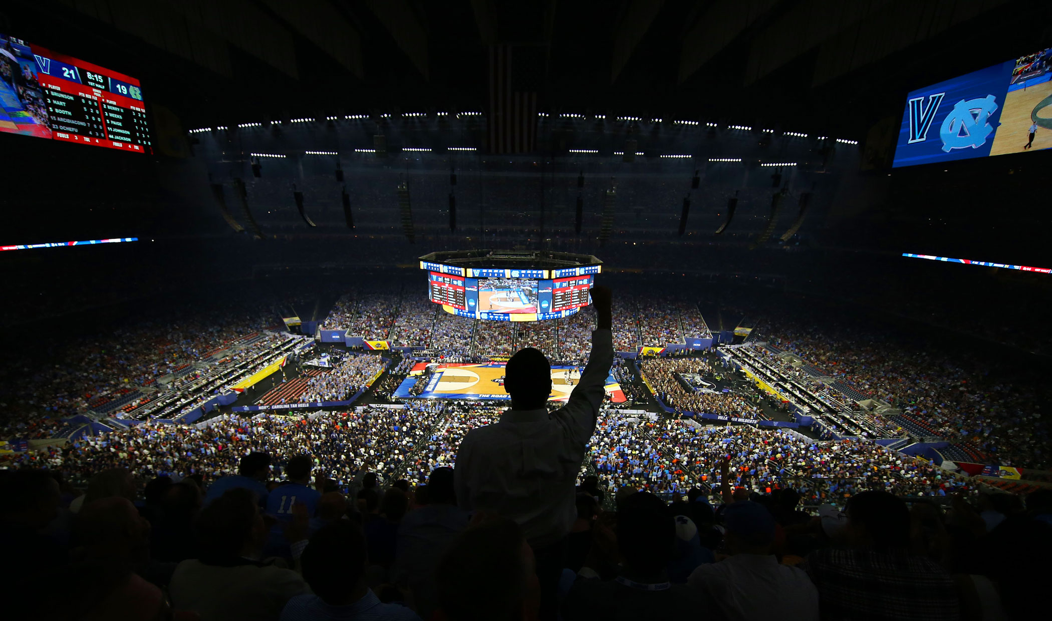 Fans cheer during the first half of the NCAA college basketball National Championship  game between Villanova and North Carolina on April 4, 2016 in Houston.