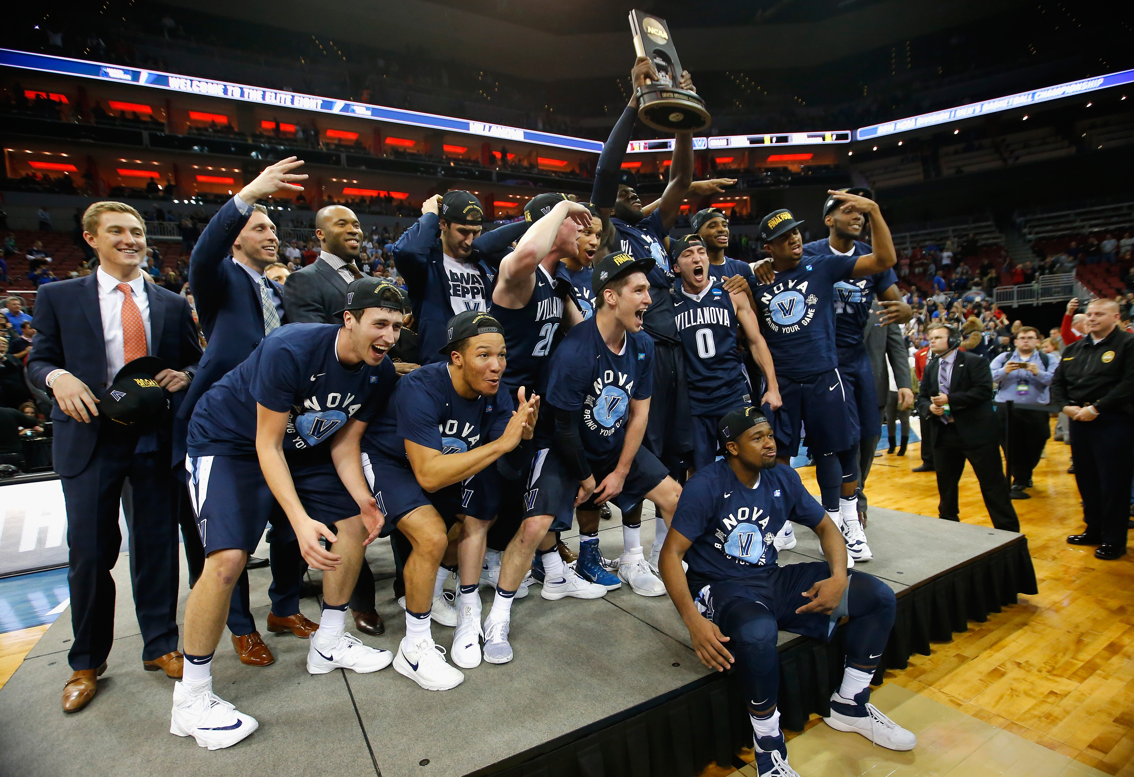 The Villanova Wildcats celebrate defeating the Kansas Jayhawks during the 2016 NCAA Men's Basketball Tournament South Regional on March 26, 2016 in Louisville, Ky.