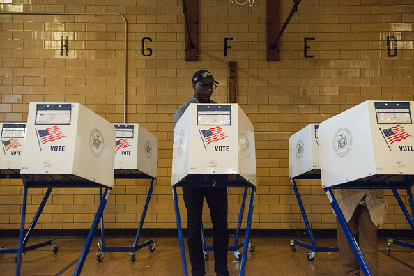 A man votes at Public School 22 on April 19, 2016 in the Brooklyn borough of New York City.