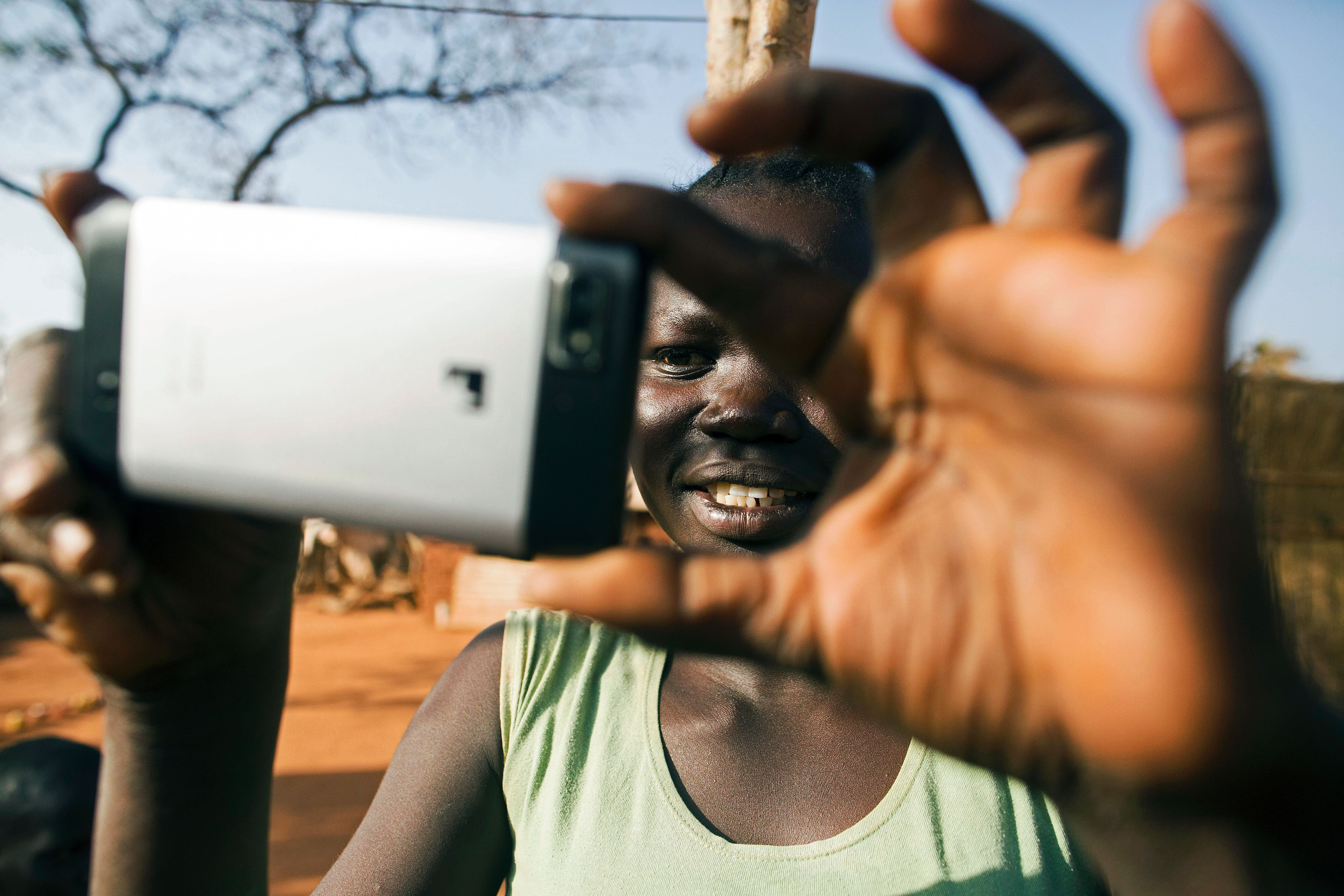 Refugee Manar Abdelaziz Mudir, 19, from South Kordofan takes pictures of her brothers, all living with her in the refugee camp of Ajuong Thok in South Sudan, on Jan. 27, 2016.