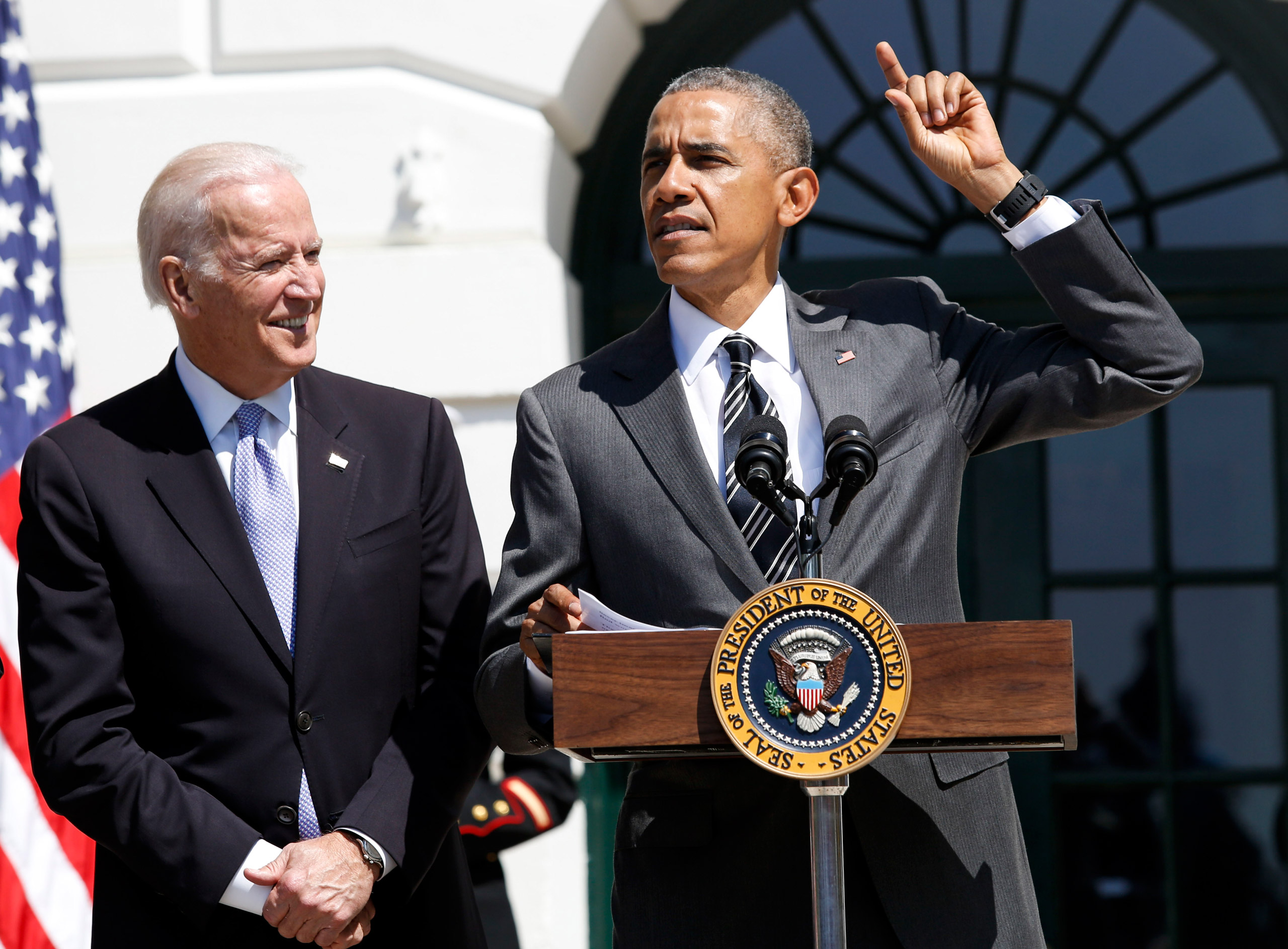 President Barack Obama speaks during the Wounded Warrior Ride event while Vice President Joe Biden listens at the White House in Washington on April 14, 2016