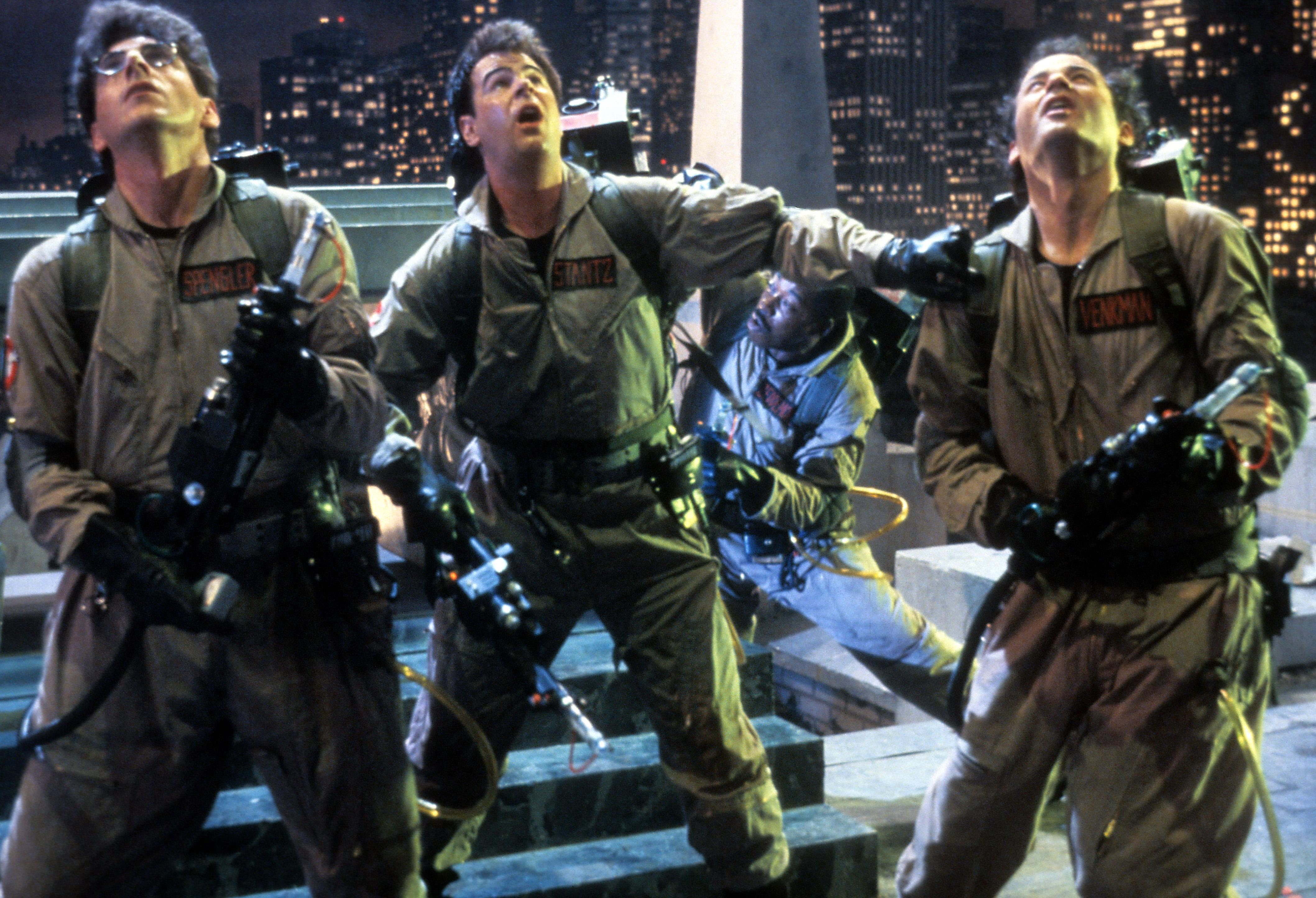Harold Ramis, Dan Aykroyd, and Bill Murray in a scene from the film 'Ghostbusters', 1984.