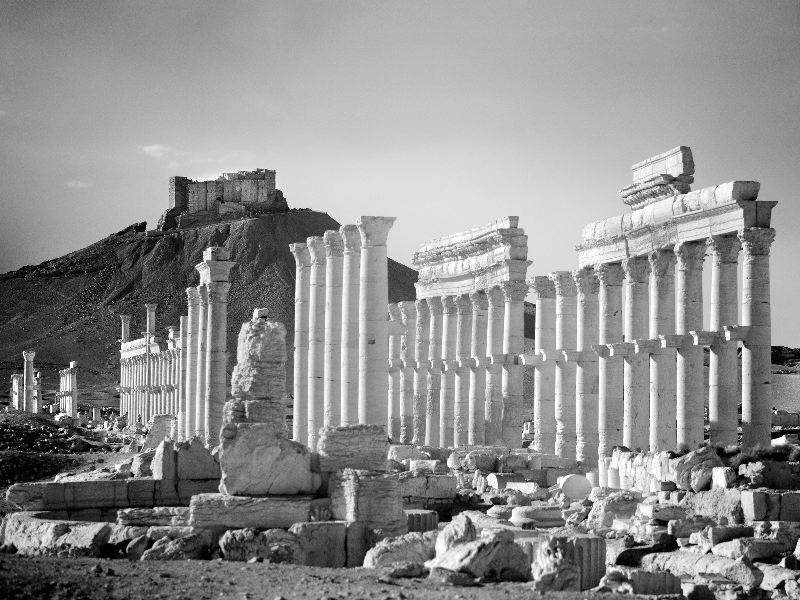 Qalaat Shirkuh looms above the ancient Roman city of Palmyra.