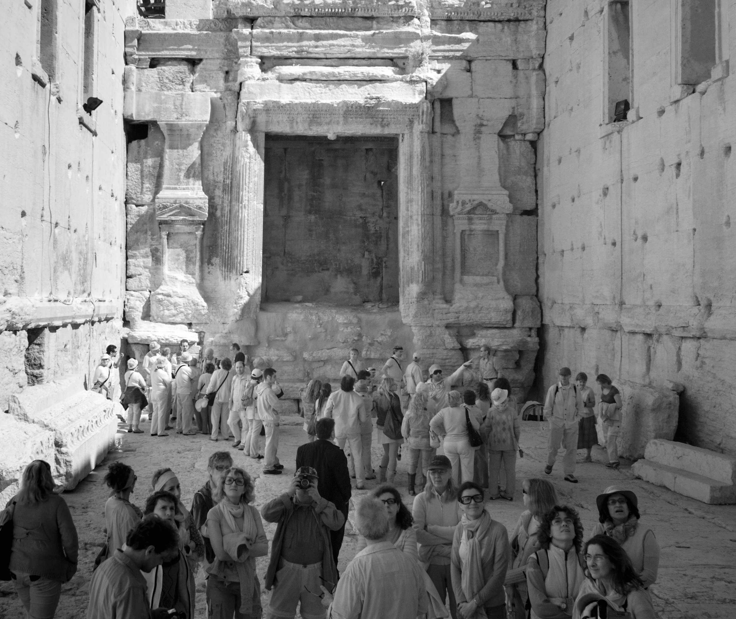 Tourists visit the site of the Temple of Bel ruins in Palmyra.