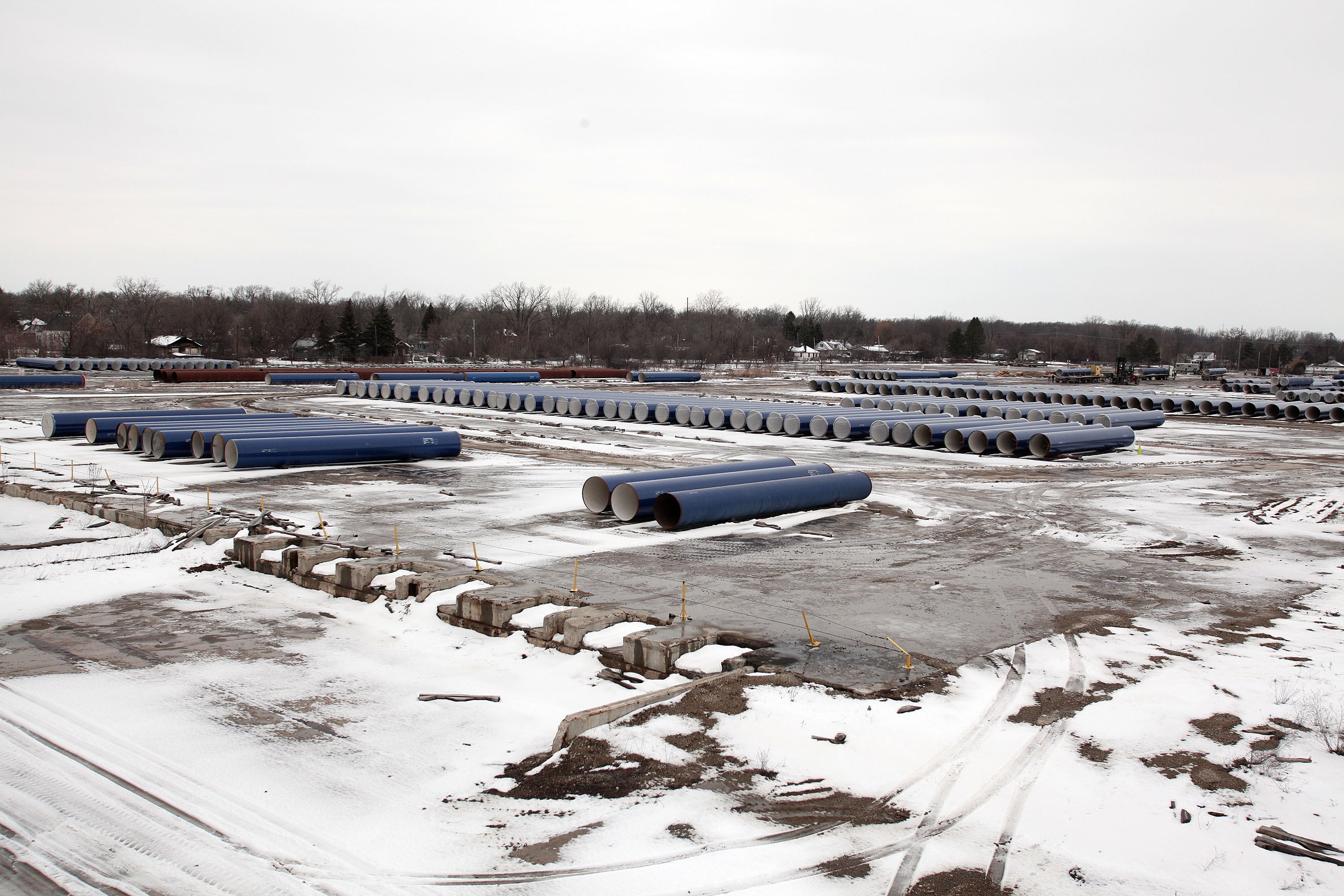New water pipes awaiting installation are shown along the route of a national mile-long march, which was held to highlight the push for clean water in Flint, Mich., on Feb. 19, 2016.