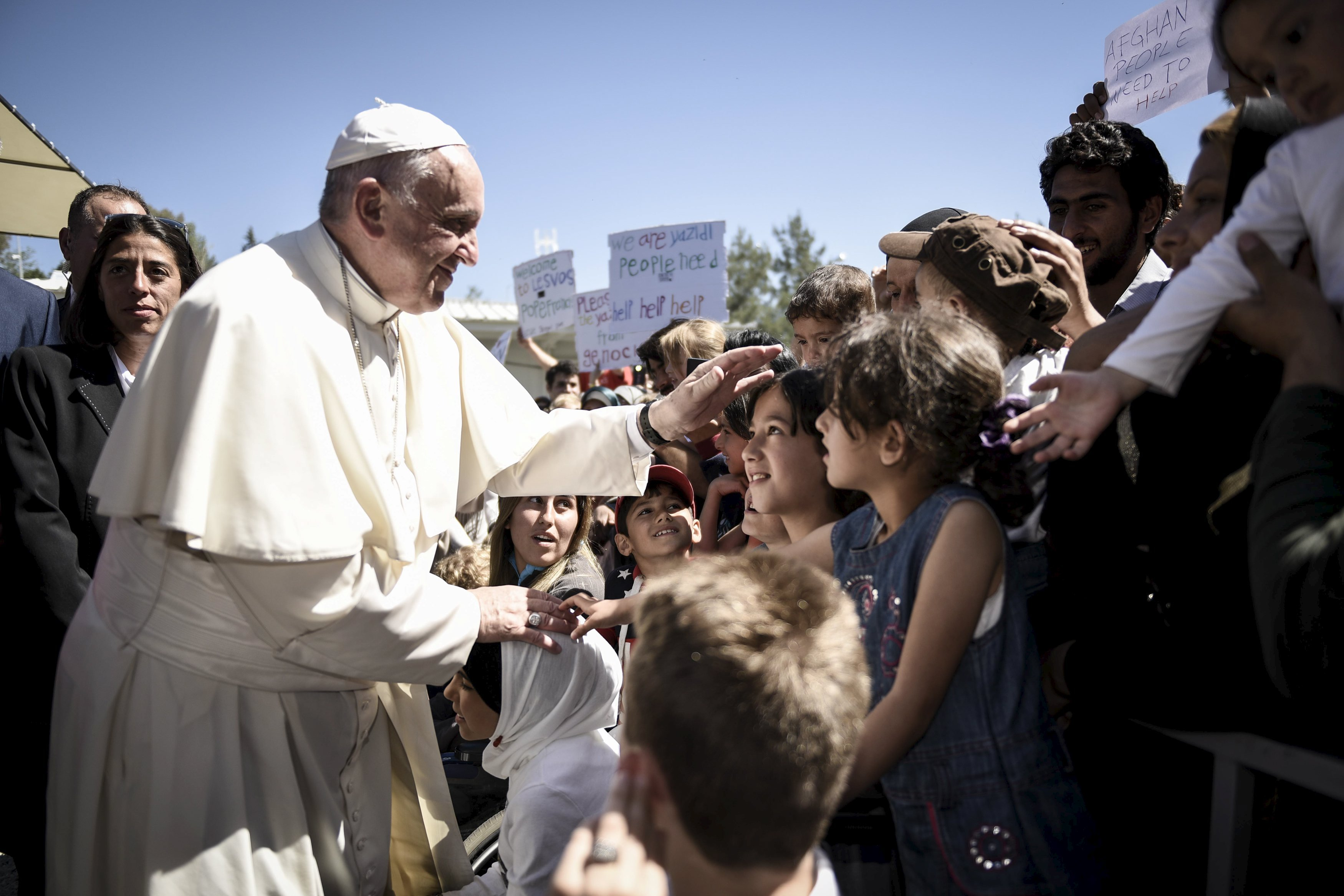 Pope Francis greets migrants and refugees at Moria refugee camp near the port of Mytilene, on the Greek island of Lesbos on April 16, 2016.