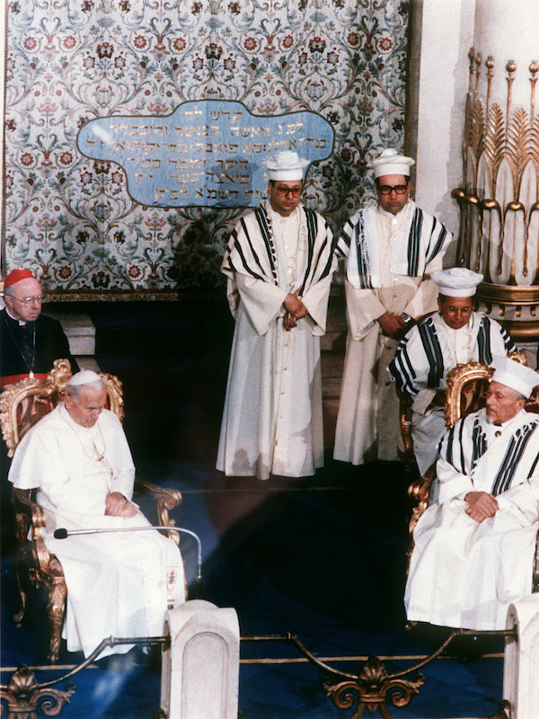 Pope John Paul II (L) April 13, 1986, in the Grand Synagogue of Rome with Jewish religious authorities.