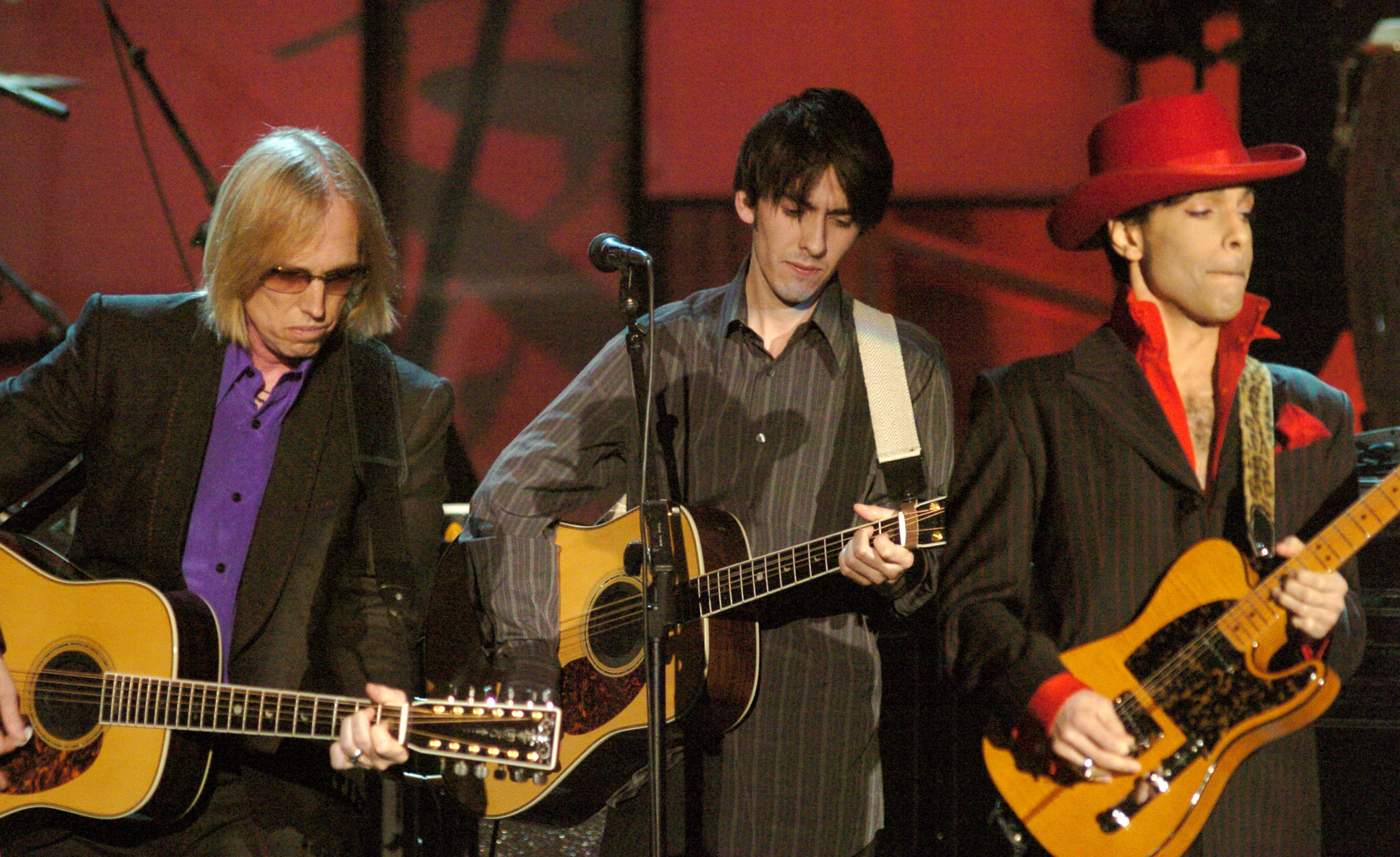 From left: Tom Petty, Dhani Harrison and Prince perform during The 19th Annual Rock and Roll Hall of Fame Induction Ceremony in New York City on March 15, 2004. Prince was inducted into the Hall of Fame that evening.