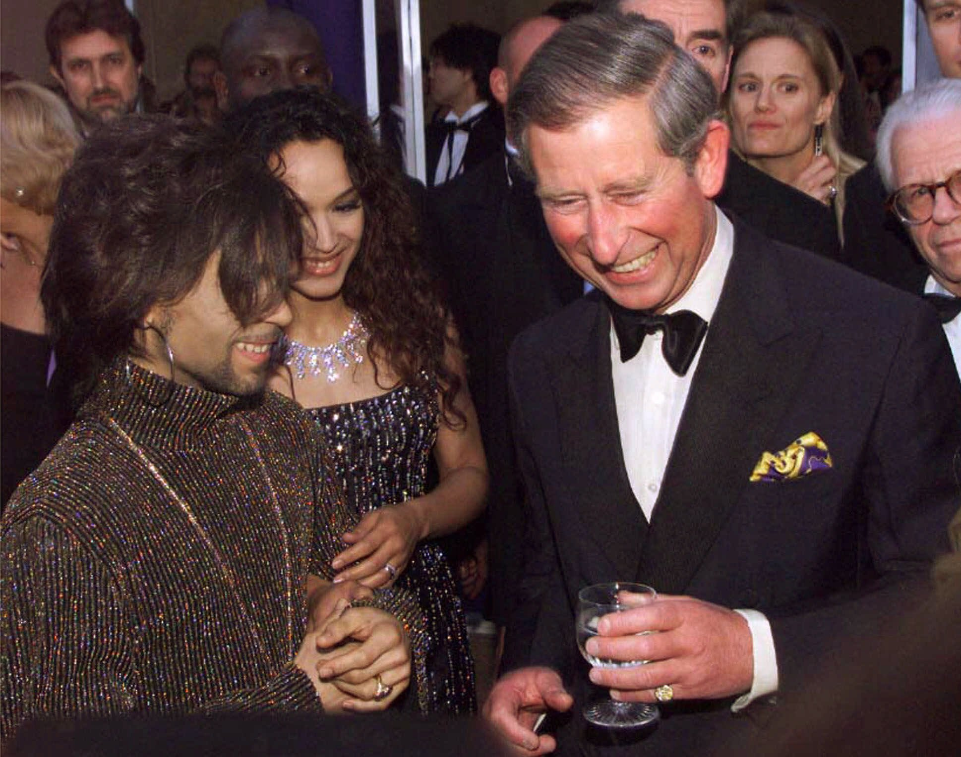 "Prince Charles, right, talks with Prince, left, at the ""Diamonds are Forever"" celebration on June 9, 1999 in London."