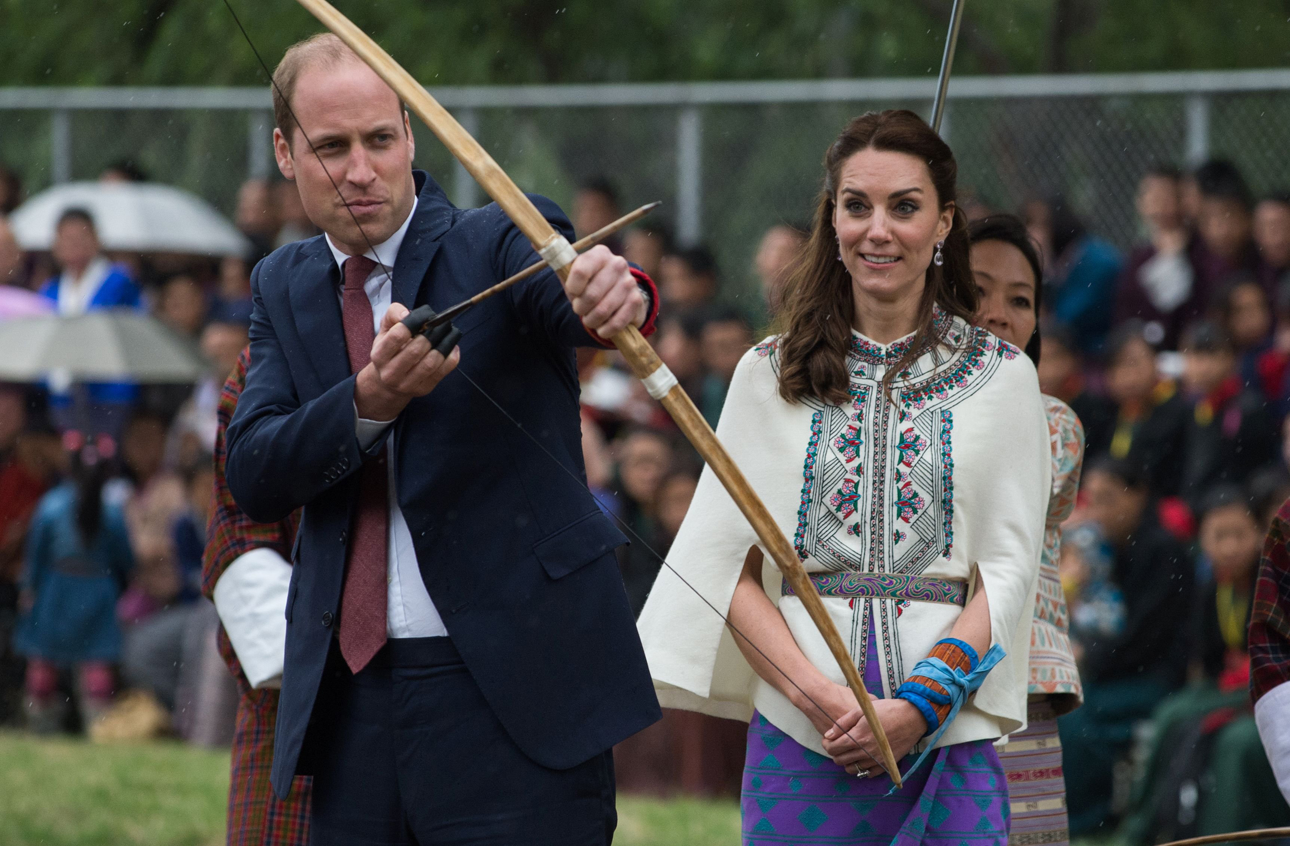 Catherine, Duchess of Cambridge, looks on as she watches Prince William, Duke of Cambridge, prepare to fire an arrow at the Changlingmethang national archery ground in Thimphu, Bhutan, April 14, 2016.