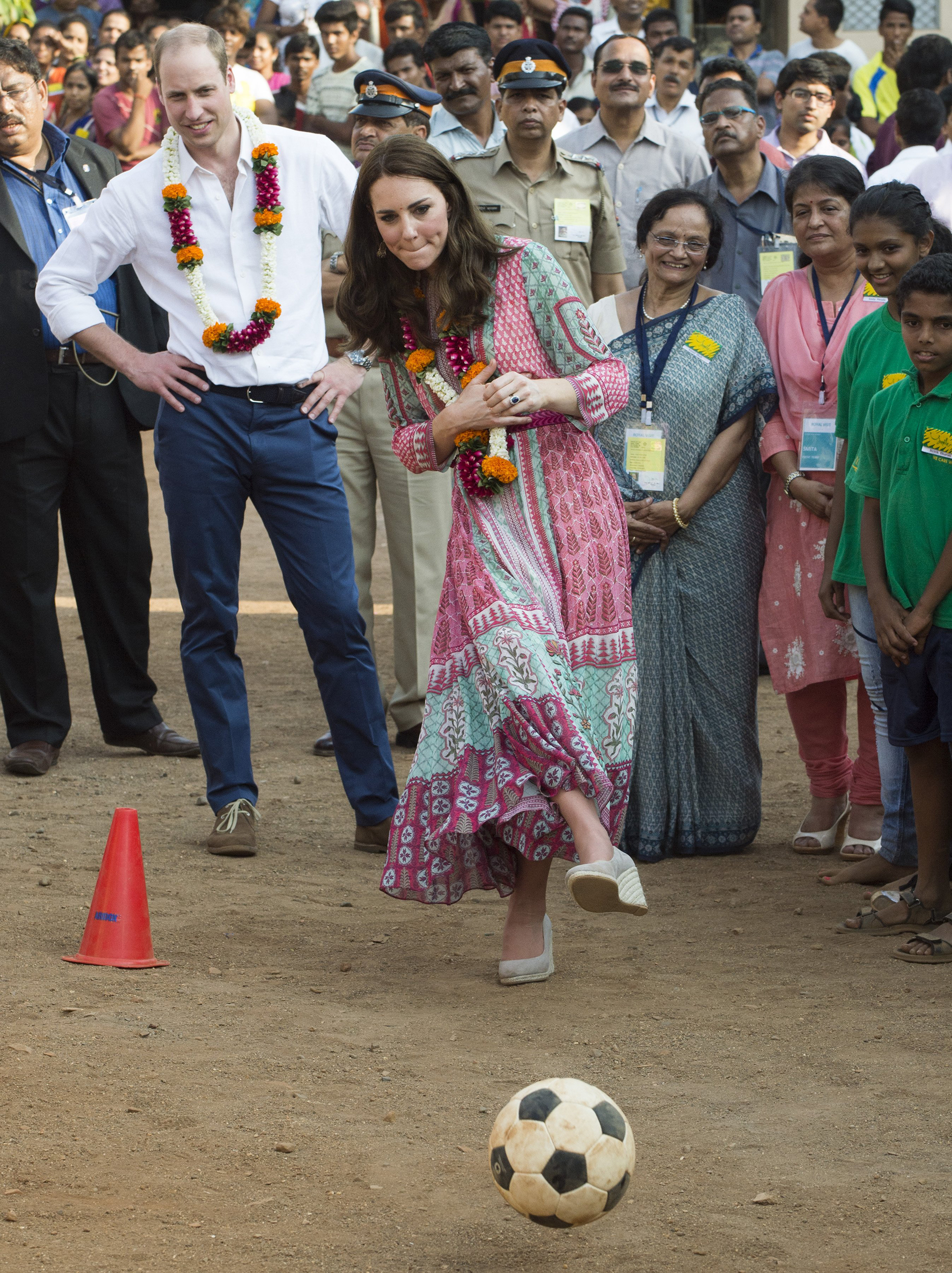 Prince William and Catherine play football games during a visit to the Banganga Water tank, where they met representatives of SMILE in Mumbai, India on April 10, 2016.