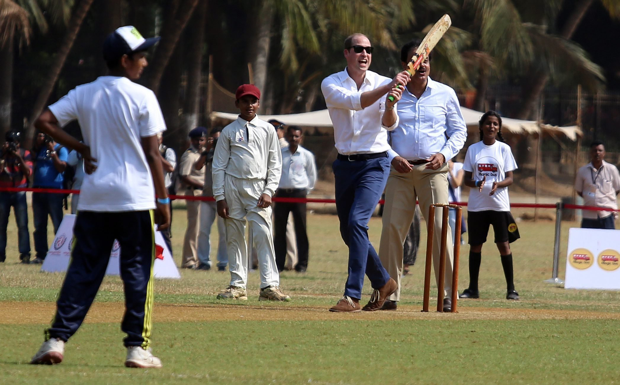 Prince William plays cricket along with children at Oval Maidan recreational ground in Mumbai, India on April 10, 2016.
