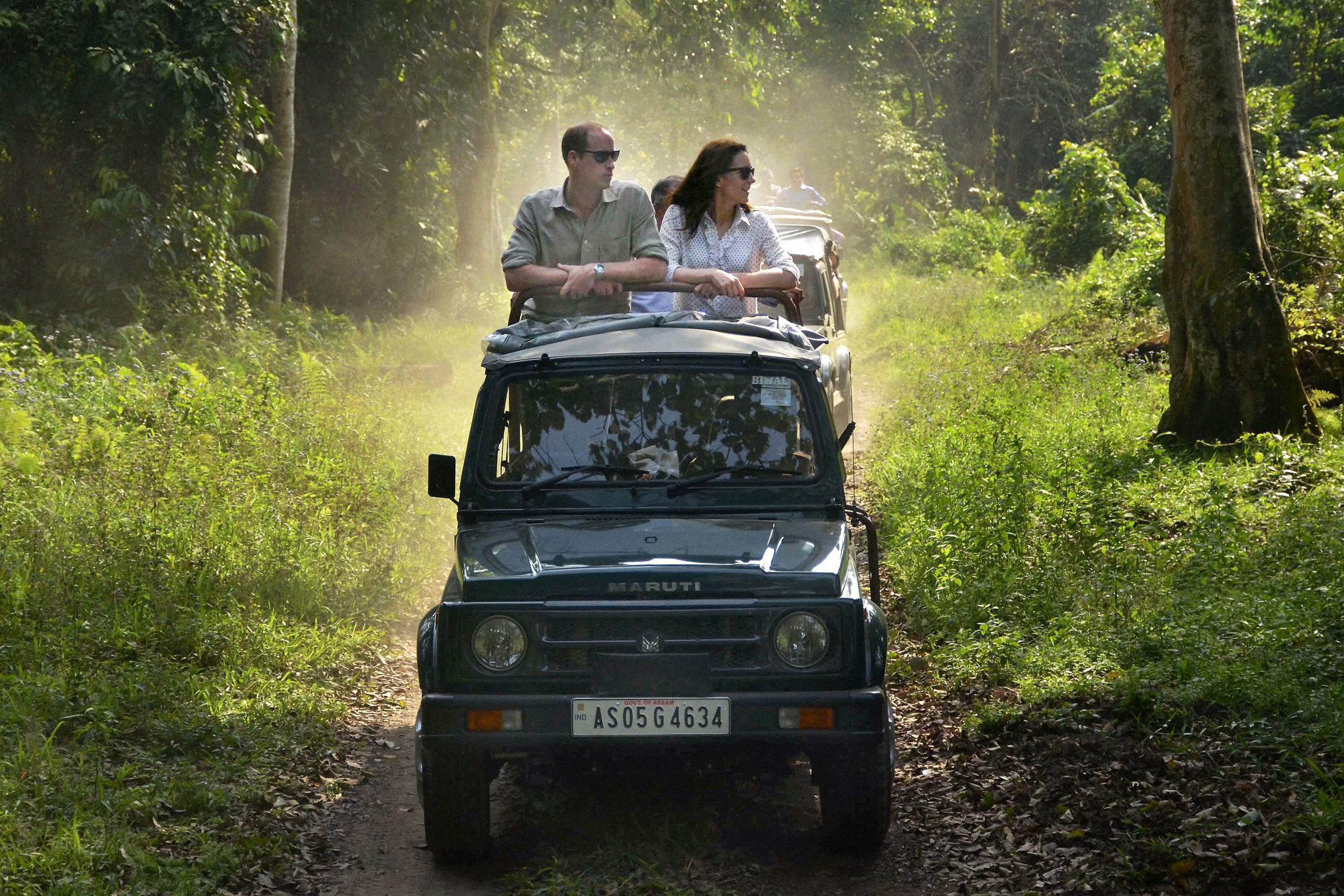 Prince William and Kate, the Duchess of Cambridge take an open vehicle safari inside the Kaziranga National Park, east of Gauhati, northeastern Assam state, India on April 13, 2016. The royal couple spent several hours at the Kaziranga National Park in hopes of drawing attention to the plight of endangered animals, including the park's 2,200-population of a rare, one-horned rhinos.